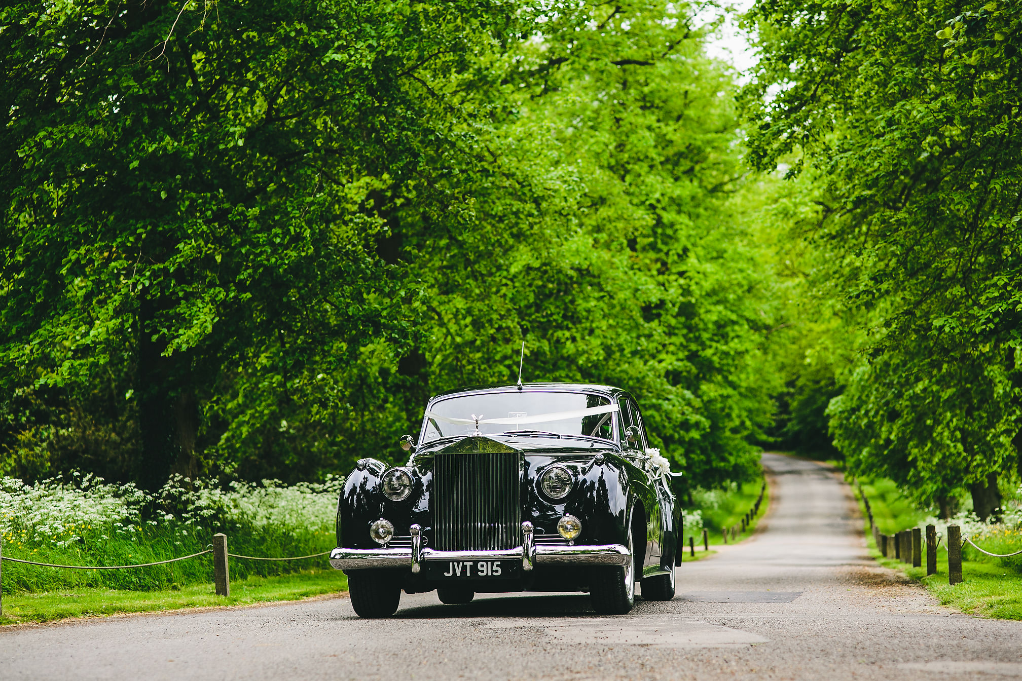 Wedding car arriving at Kelmarsh Hall, Northants