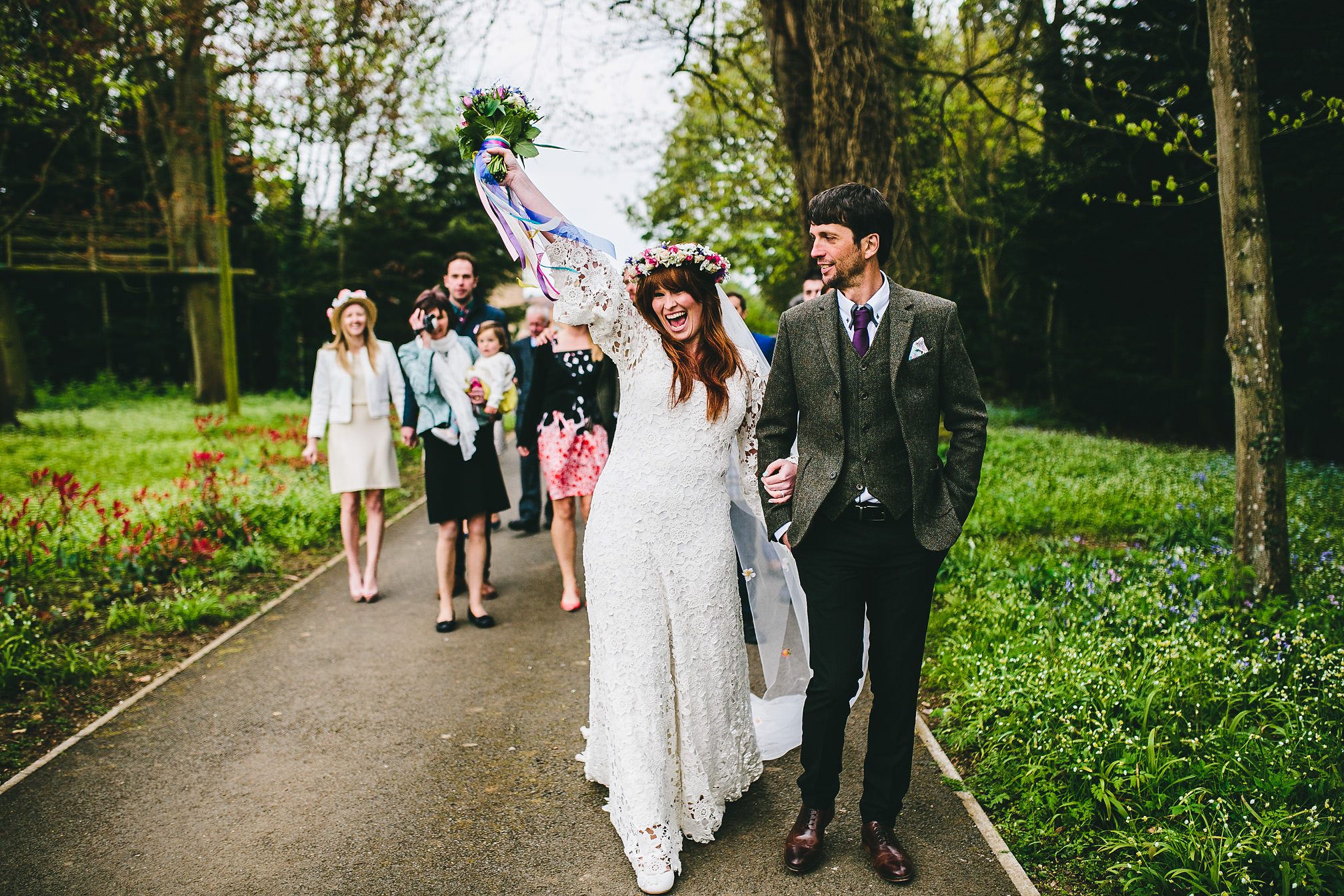Happy bride walks from church to reception venue