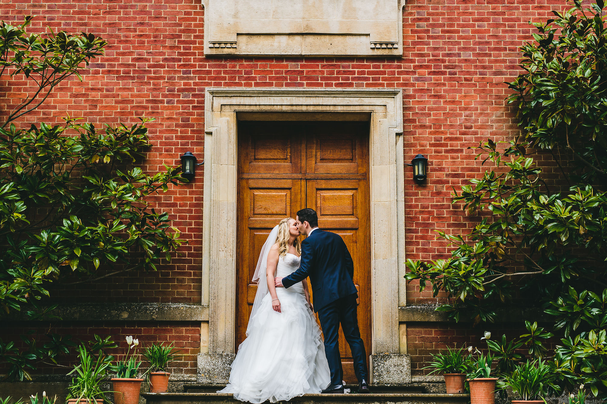 Wedding kissing at Kelmarsh Hall