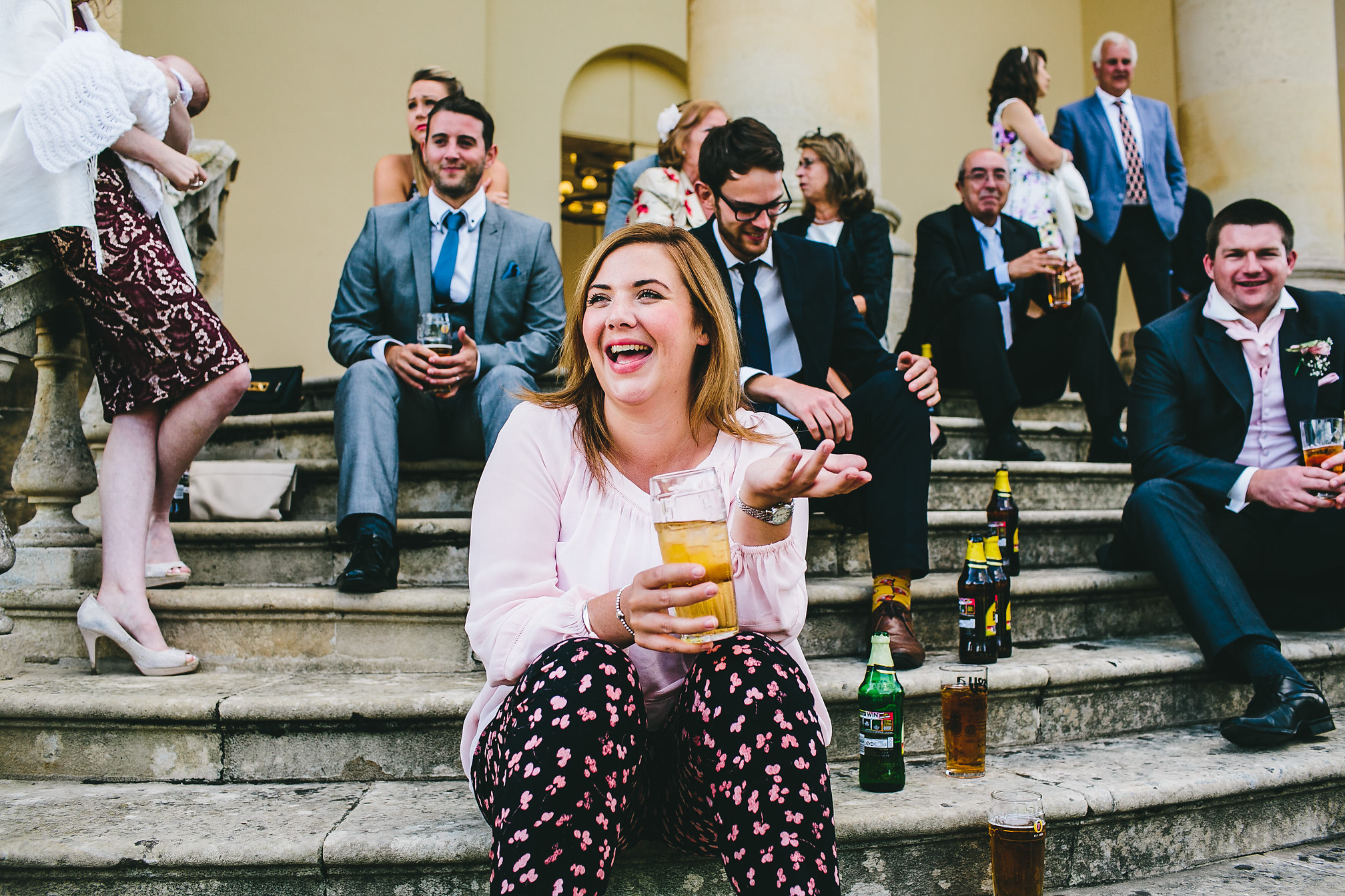 Wedding guest drinking beer