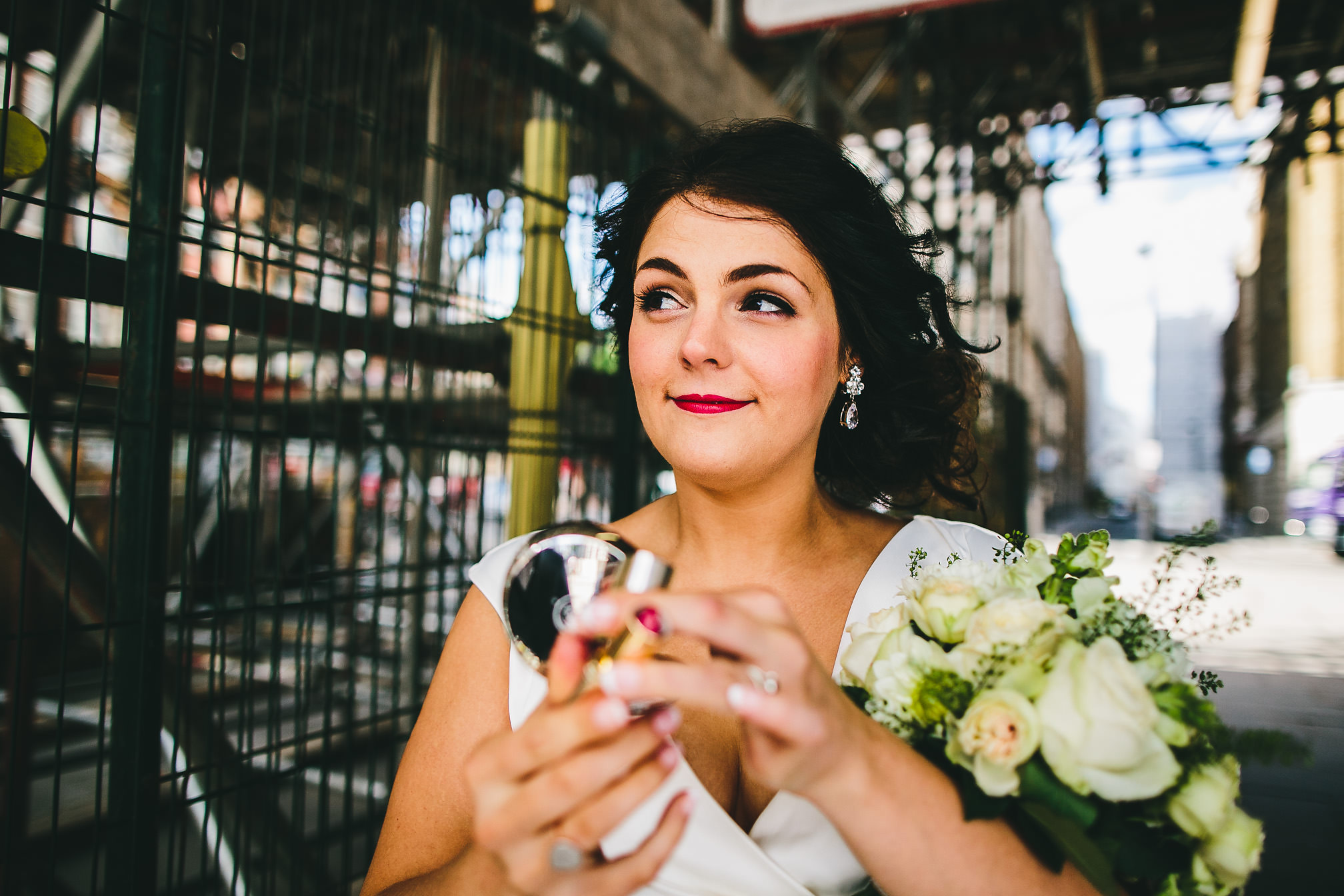 Urban bride doing her lipstick