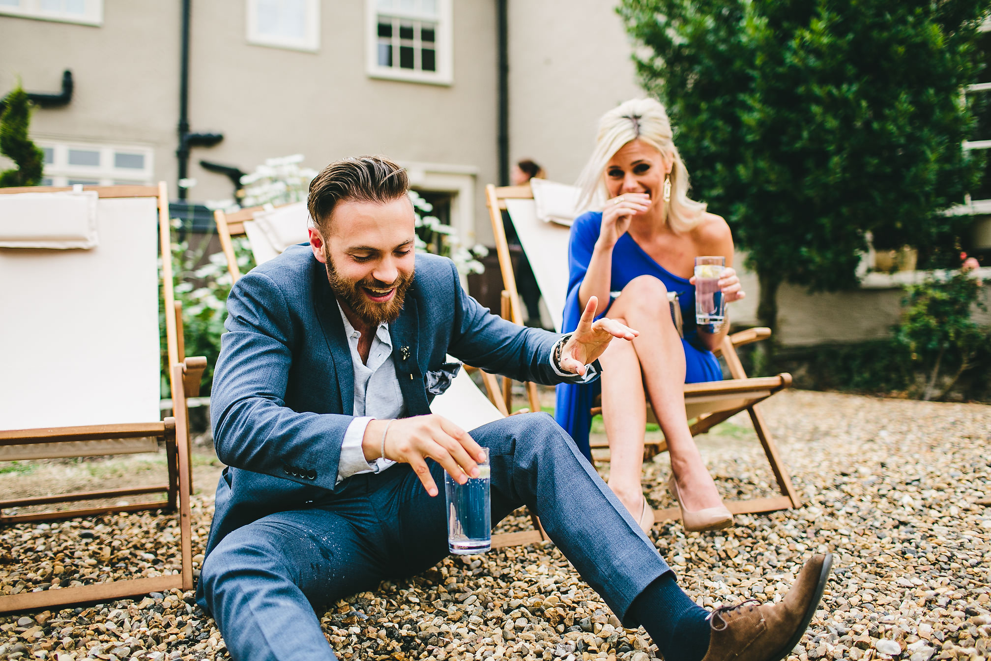 Wedding guest falling on the floor with his girlfriend laughing