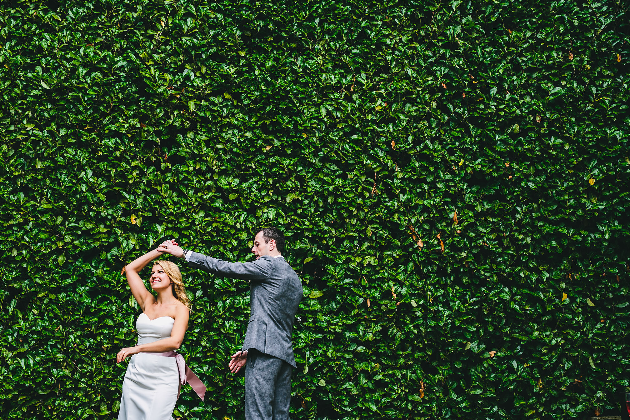 Couple's first dance in-front of a huge bush