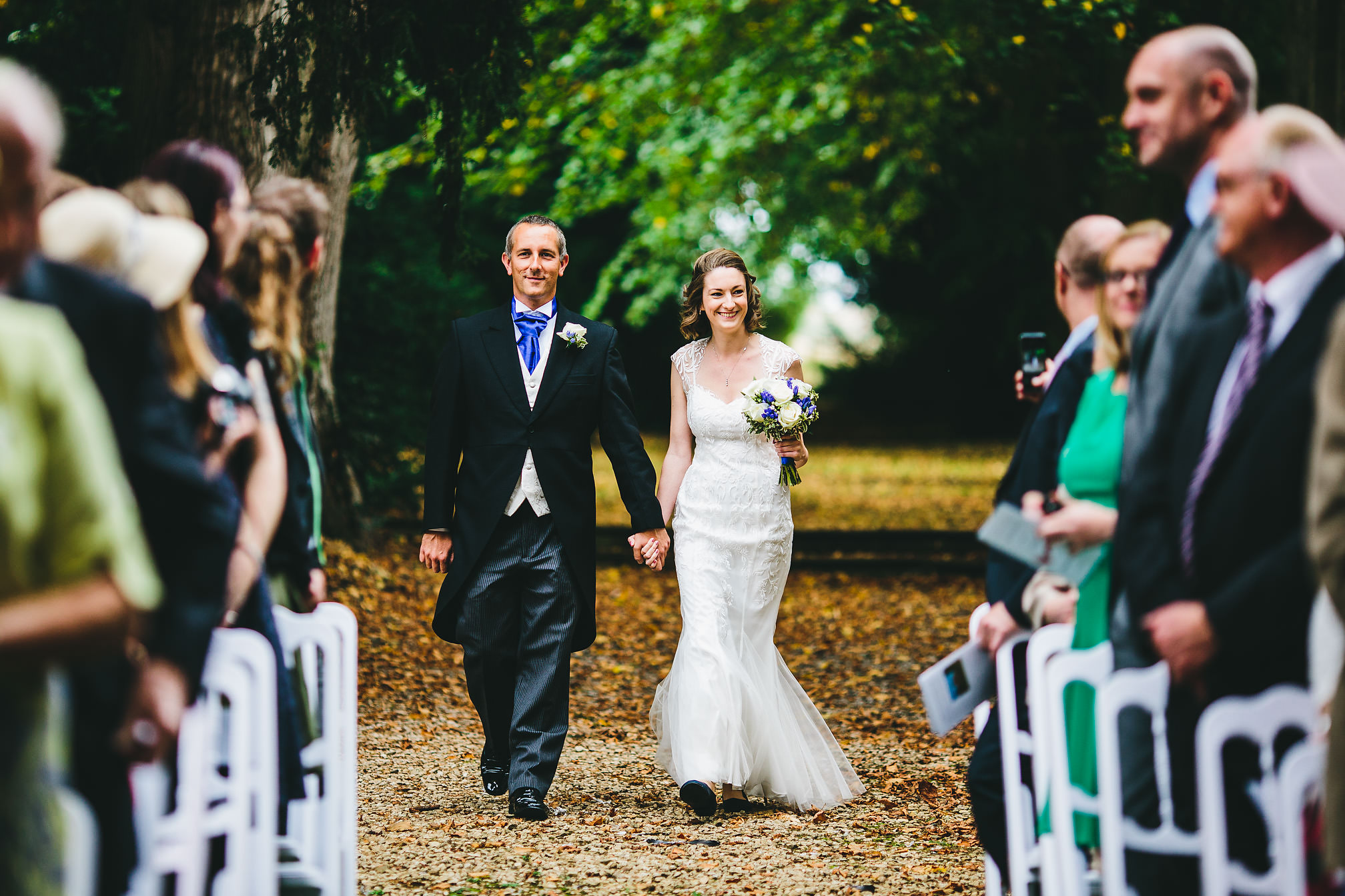 Couple arrive together for their outdoor wedding