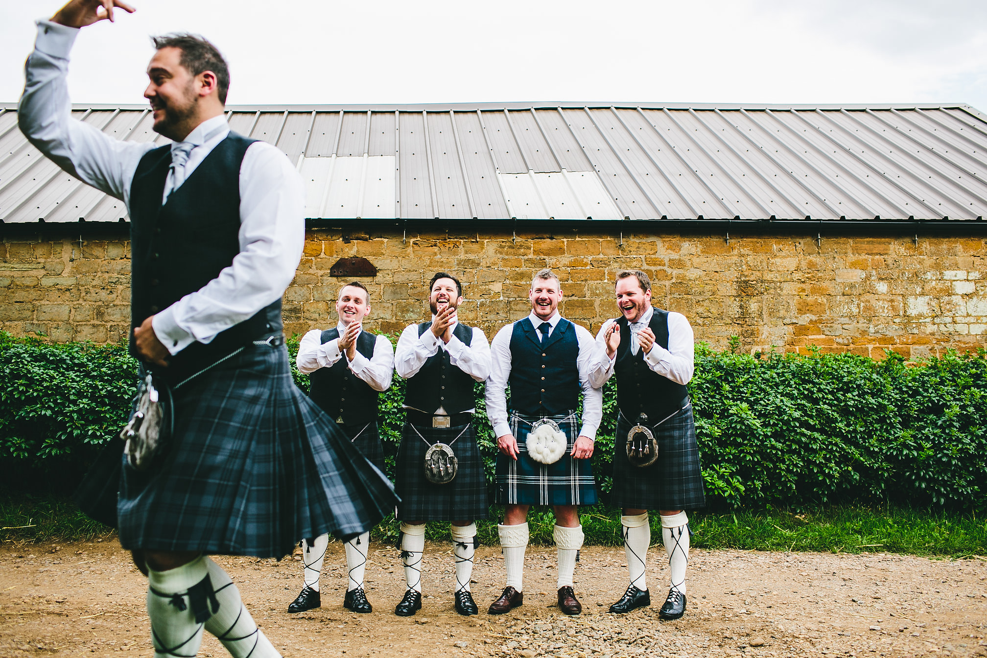 Groomsman with kilt dancing