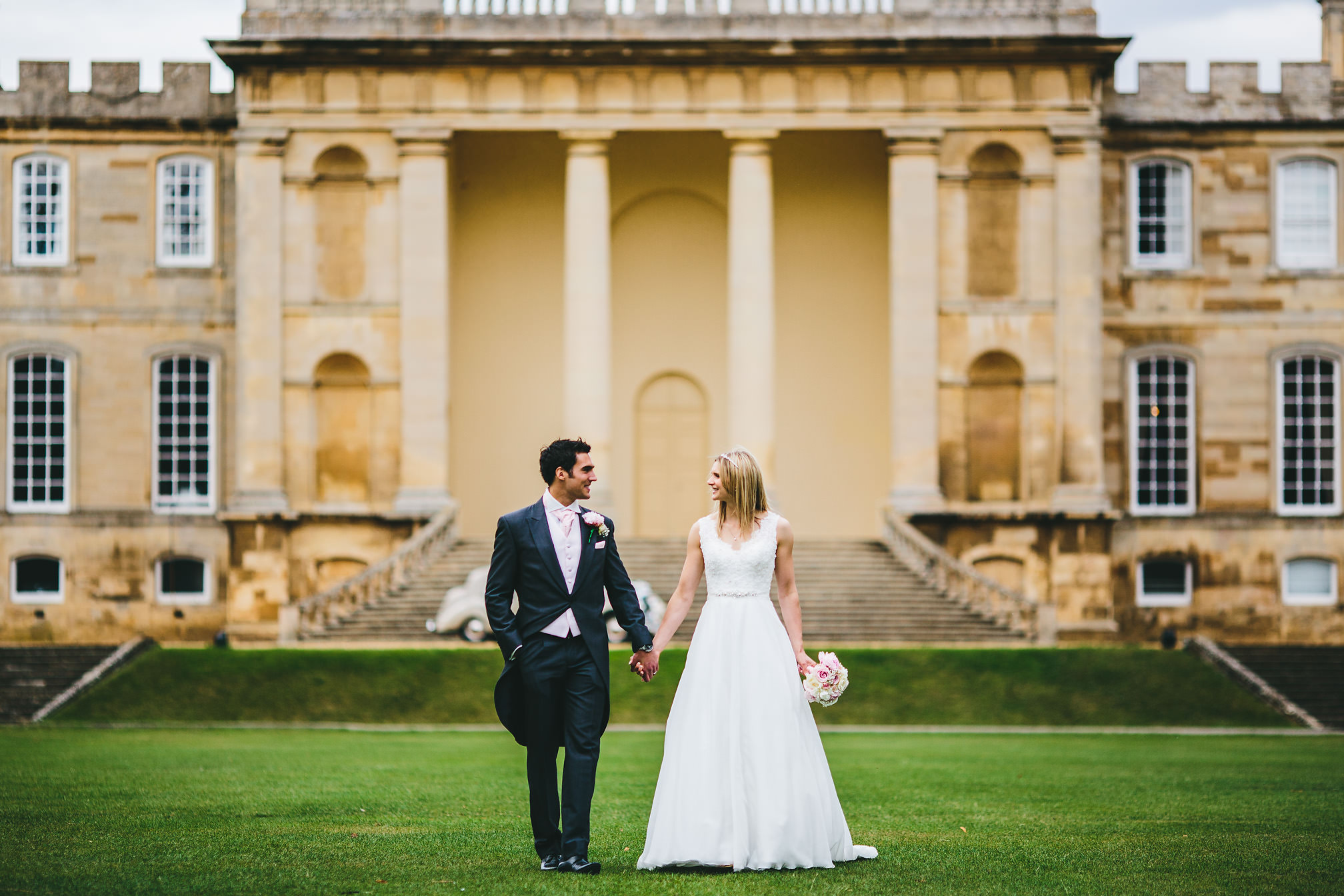 Newly married couple walking at Kimbolton Castle