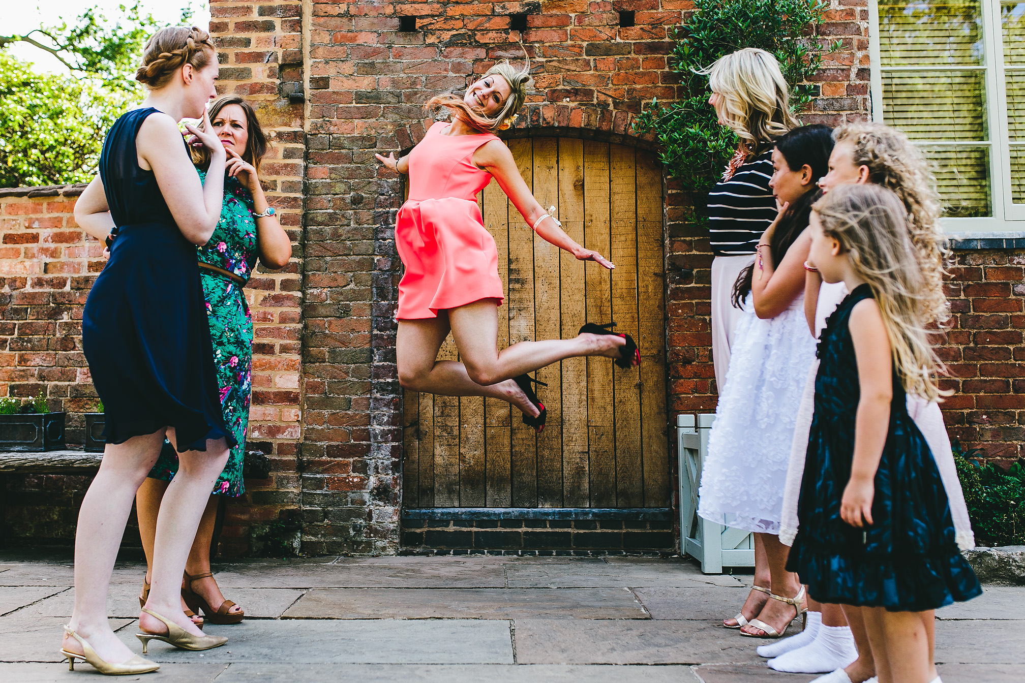 Wedding guest jumping