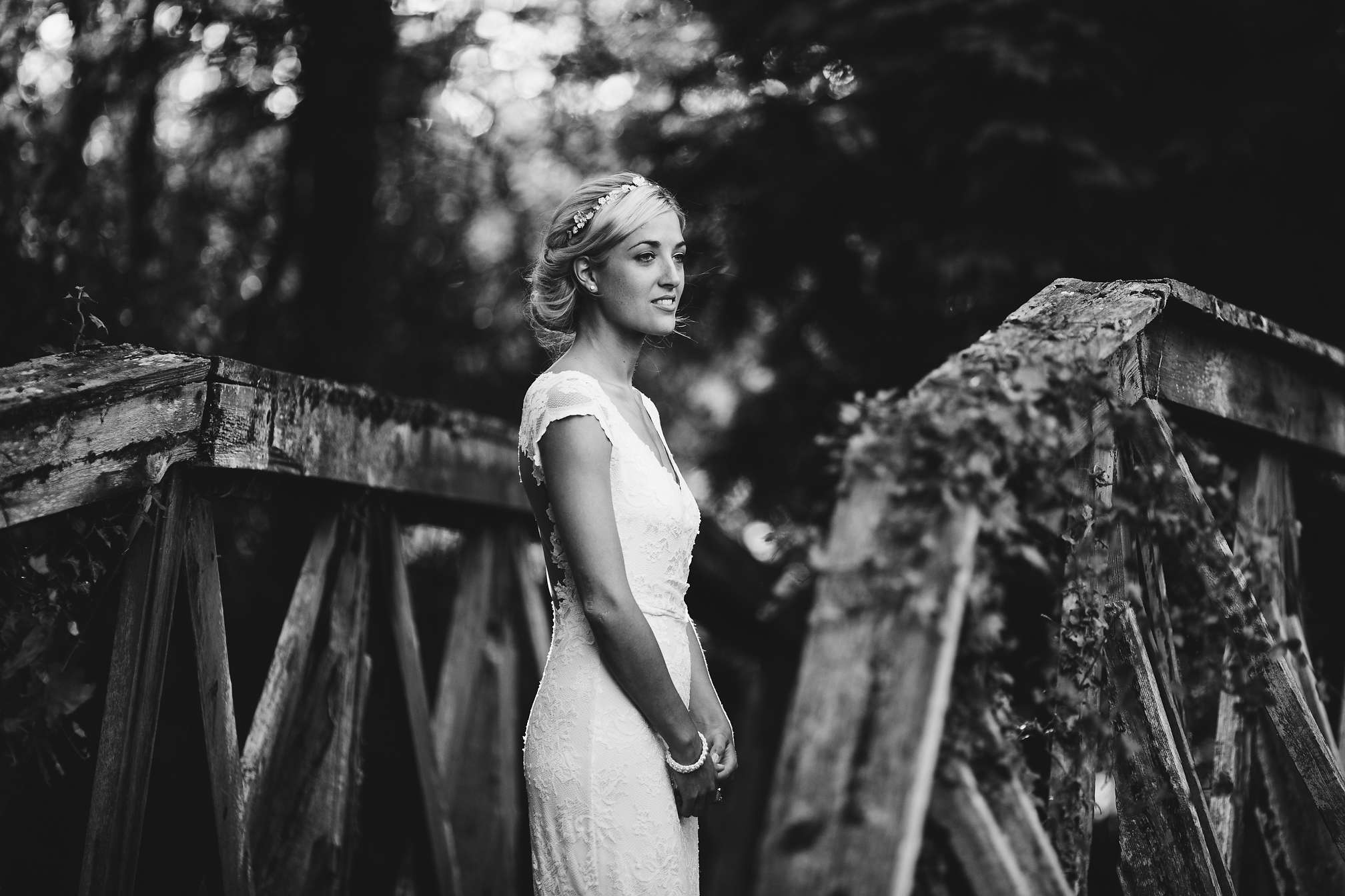 A relaxed casual picture of Jane on the wooden bridge at Brookfield Barn