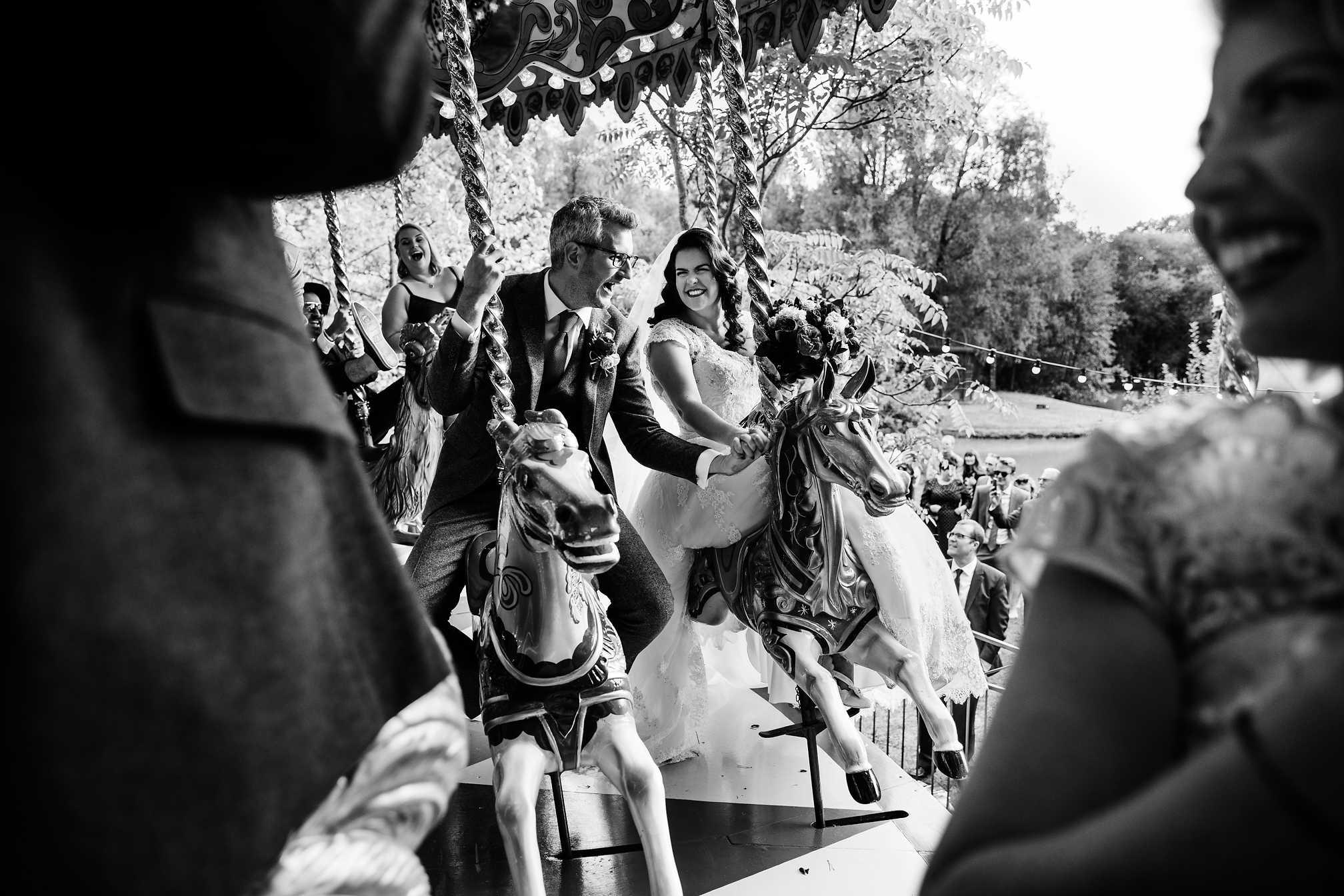 Bride and Groom on a Fairground Carousel
