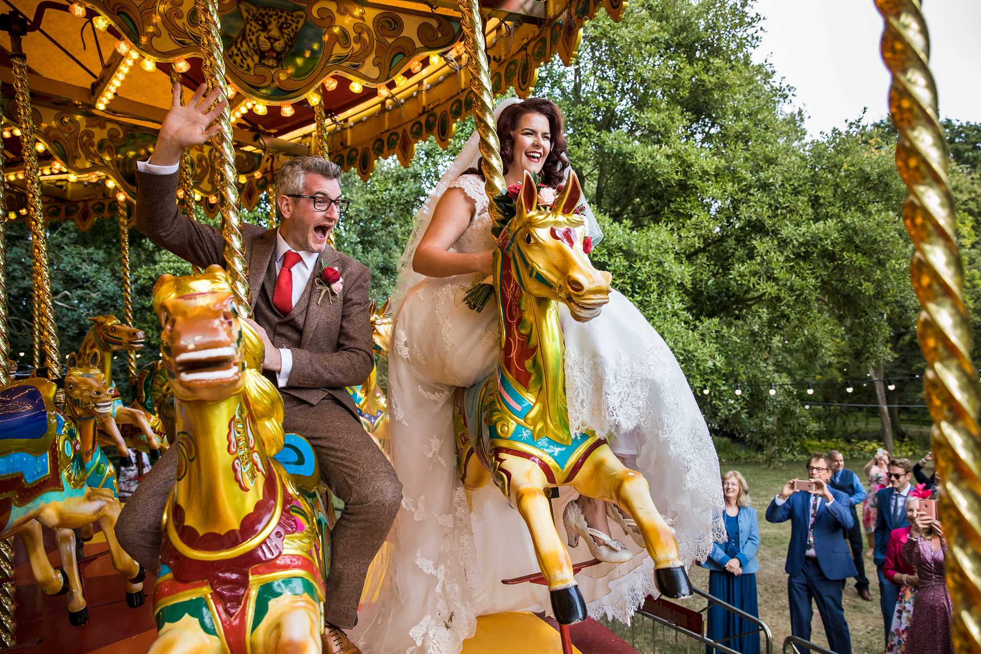Bride and Groom on a Fairground Carousel