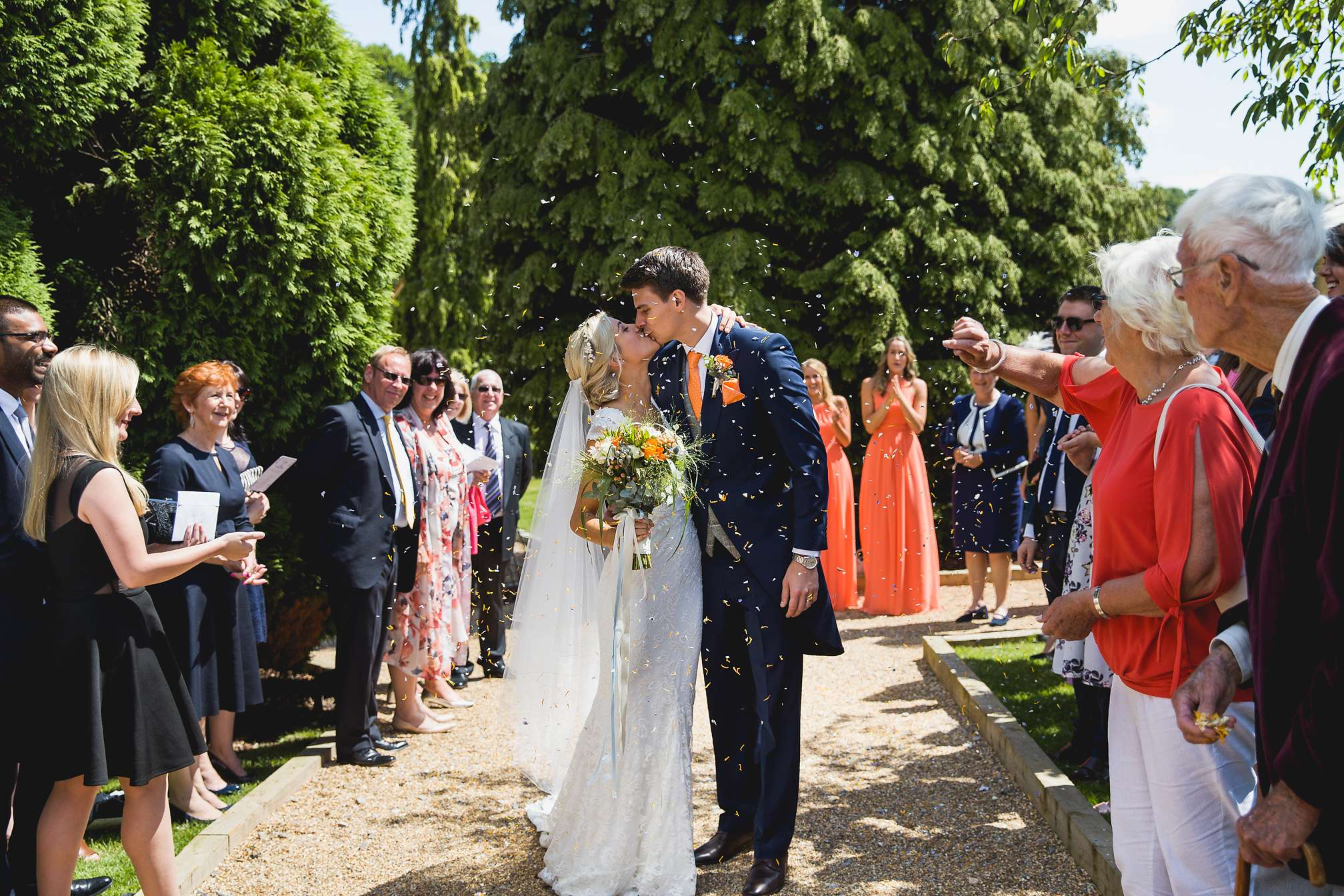 Confetti and first kiss at Brookfield Barn