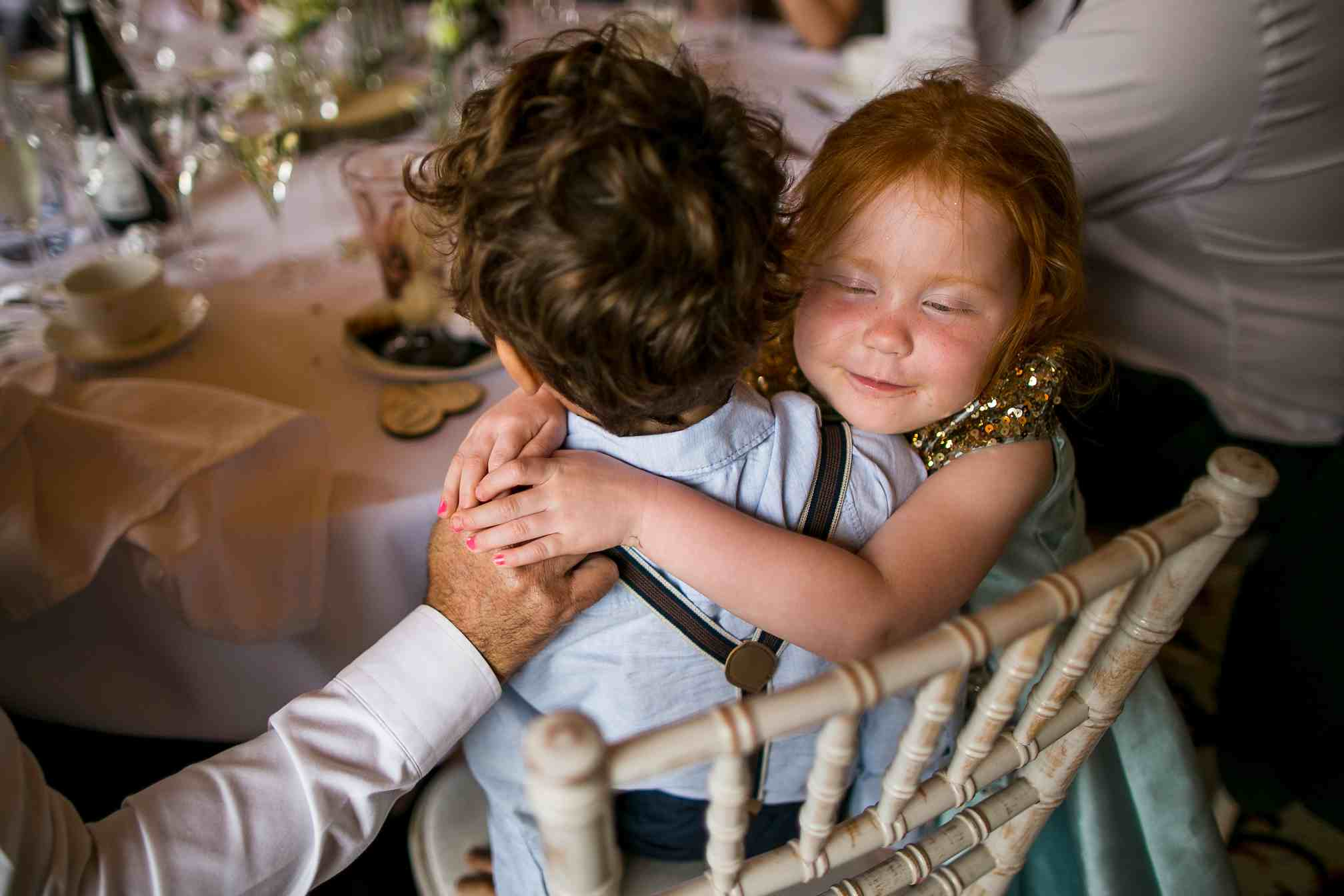 Cute flower girl cuddle