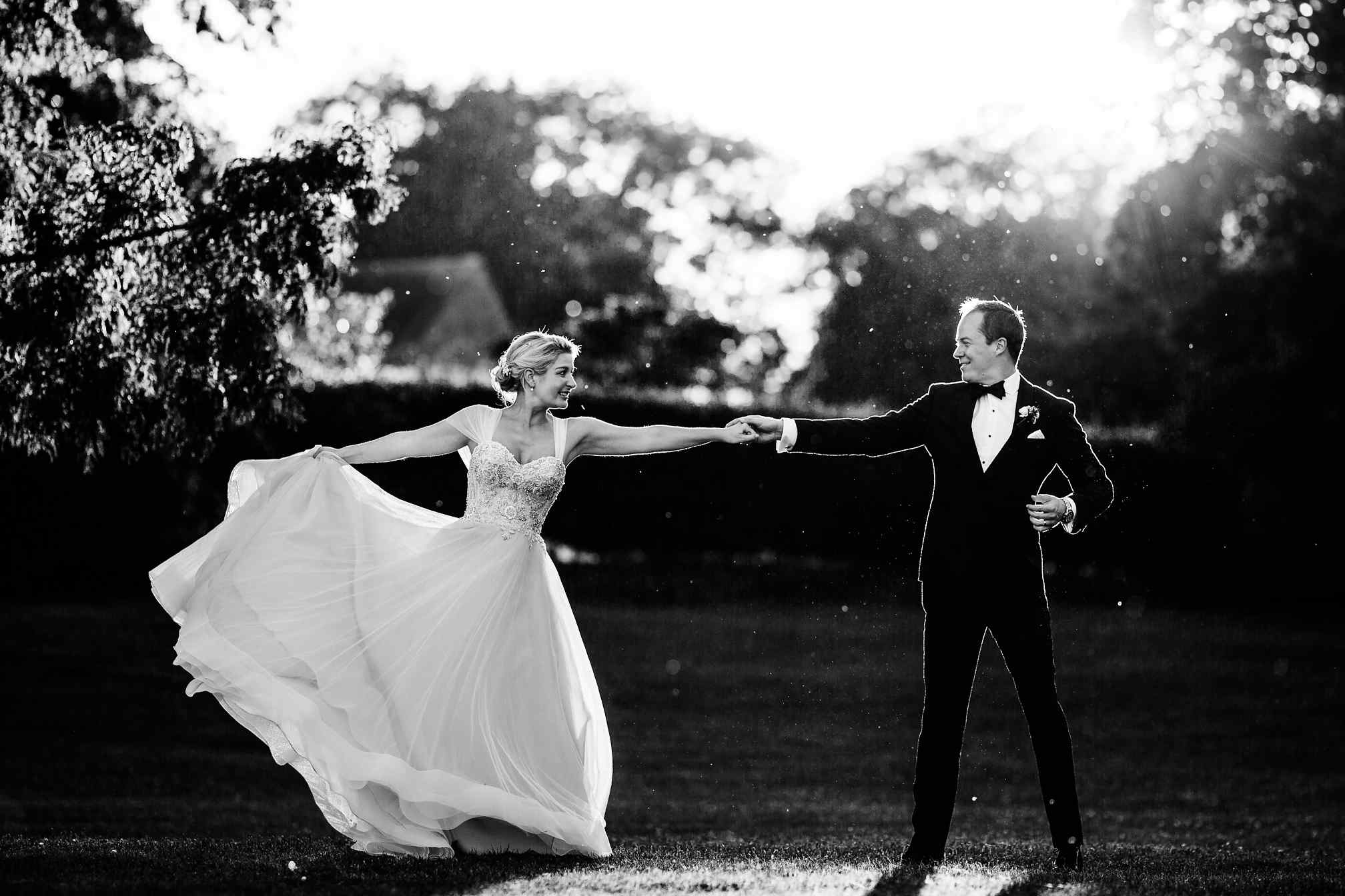 Couple dancing in the golden light at Fawsley Hall