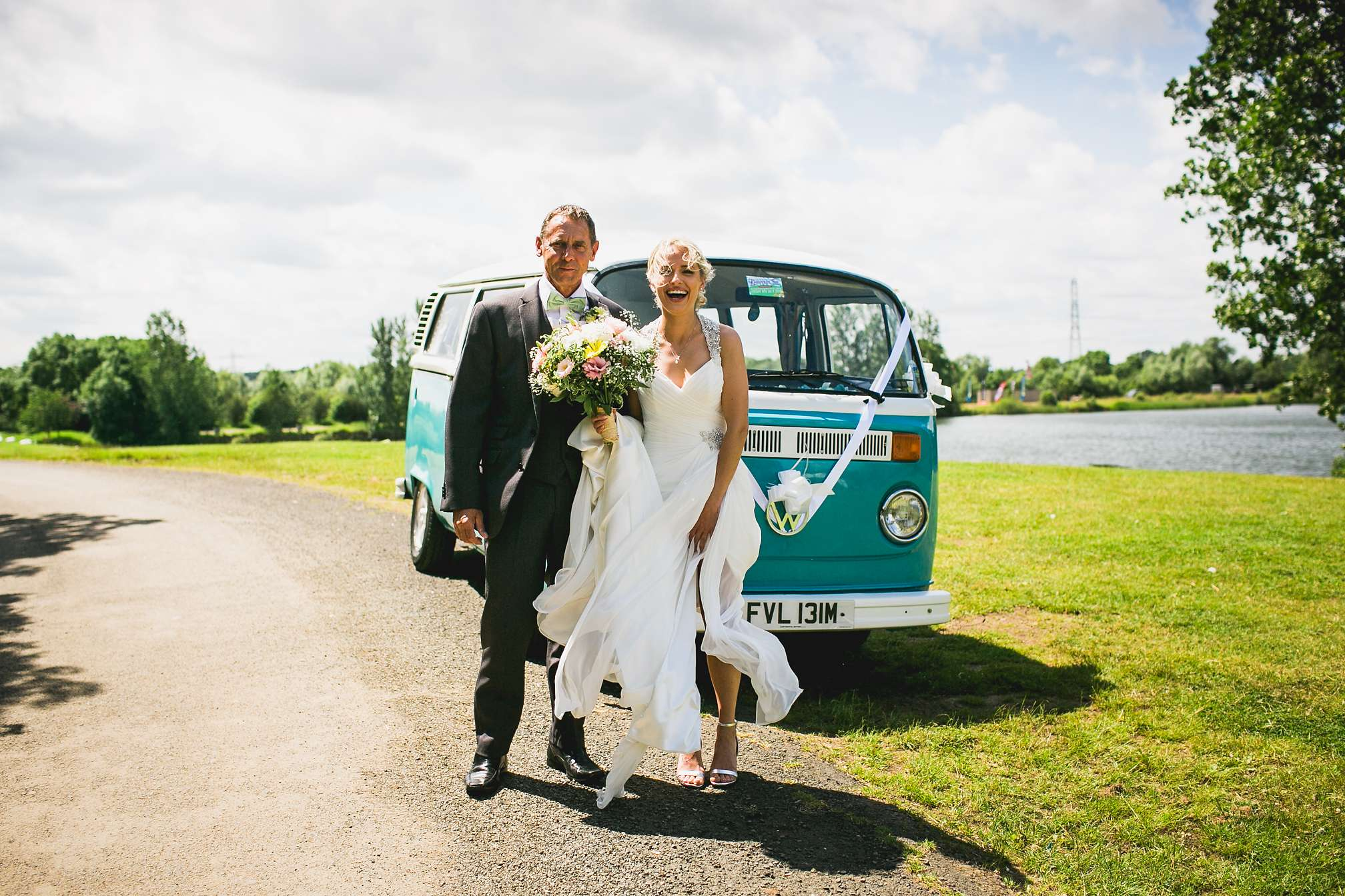 Rachel the beautiful bride at Grendon Lakes next to a classic VW Camper Van