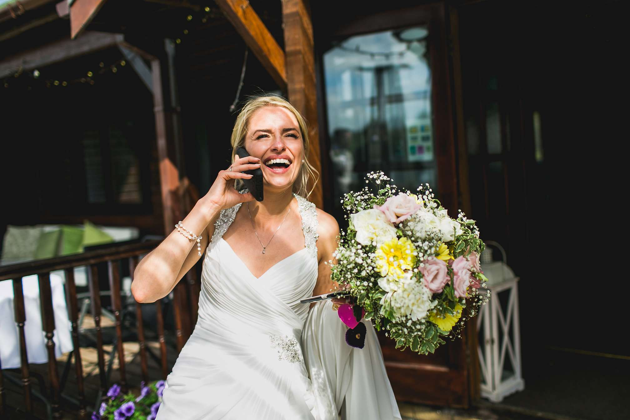Laughing bride on the phone