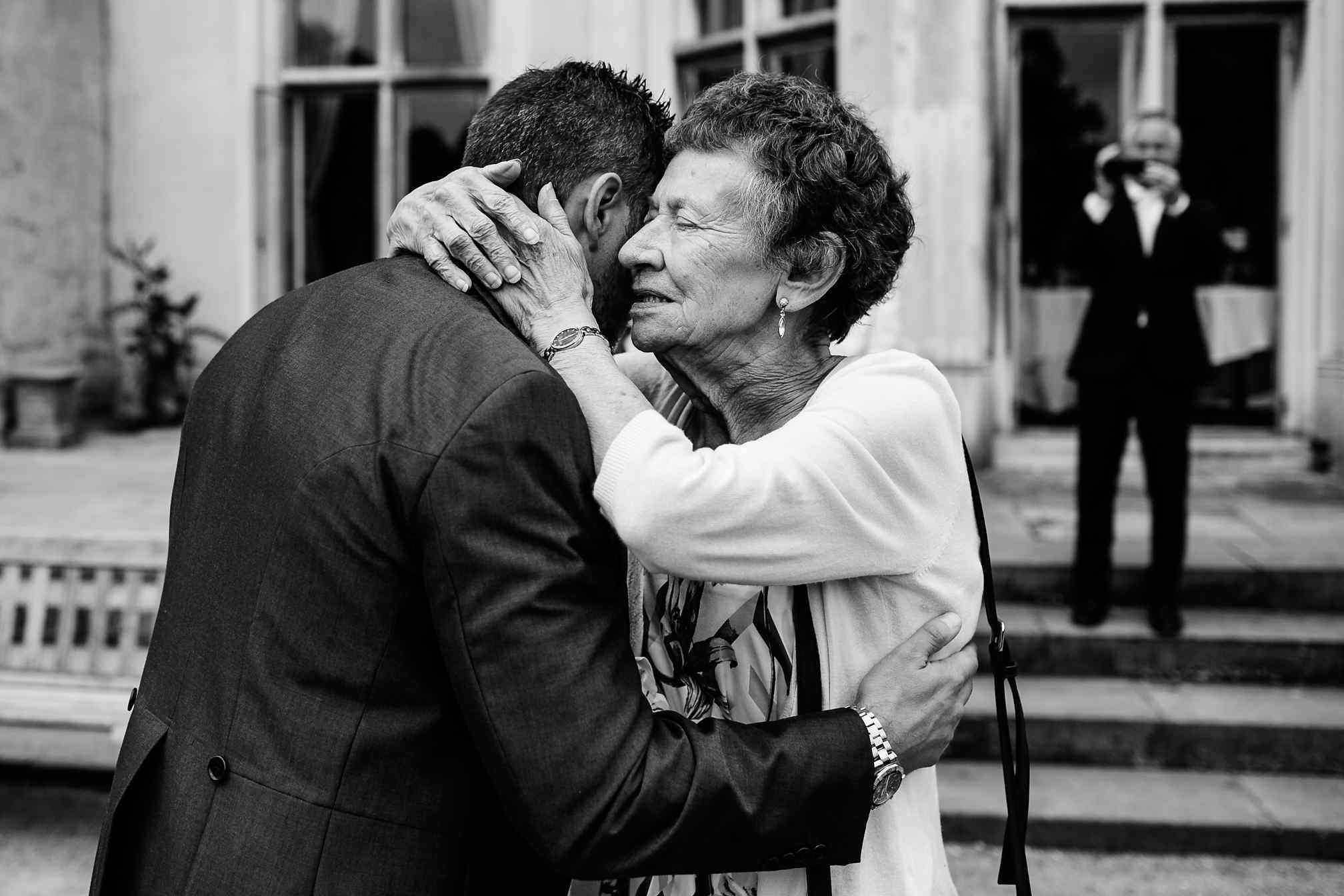 A tender hug with a groom and his Nan