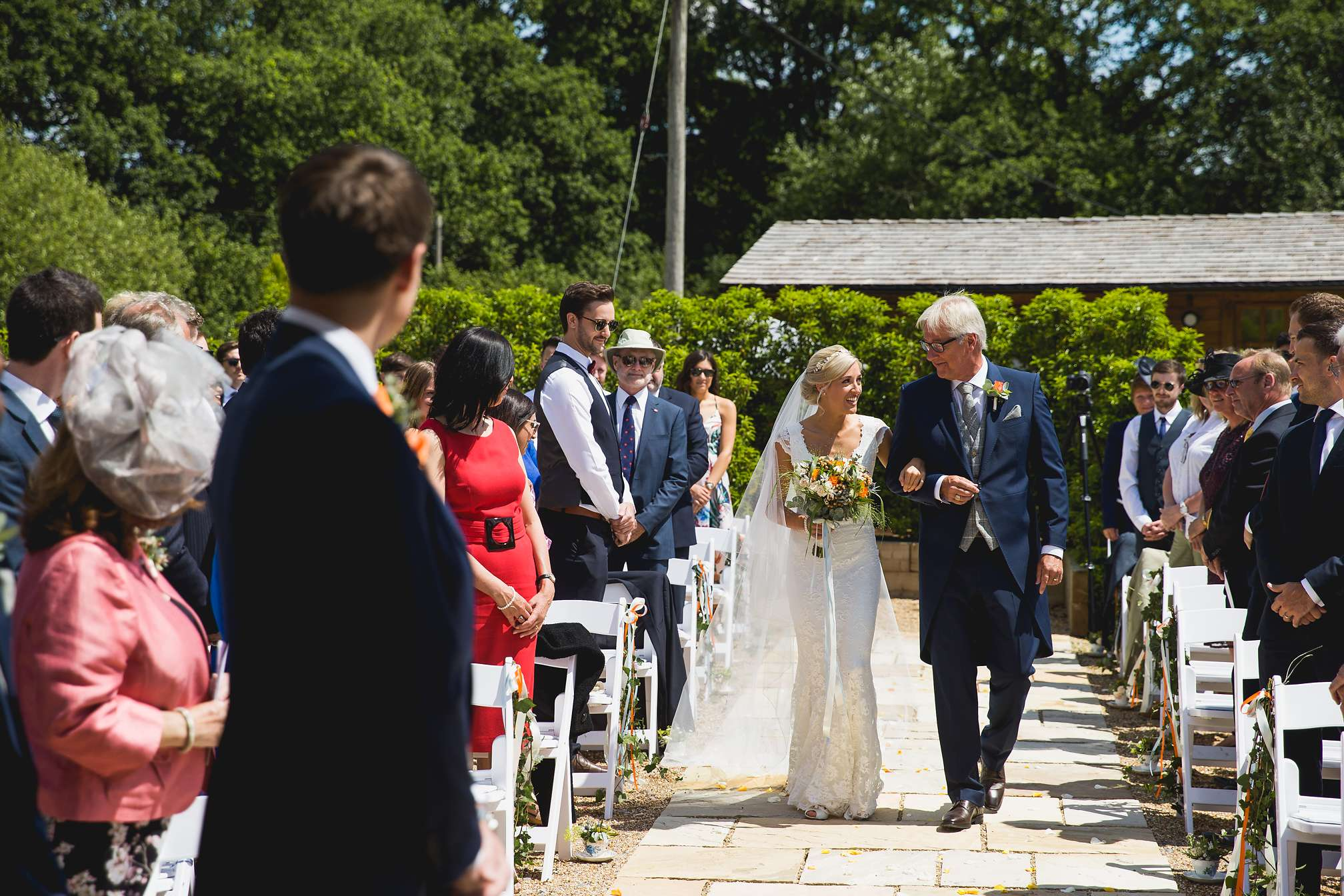 Jane and her dad haring a glance as they walk down the isle