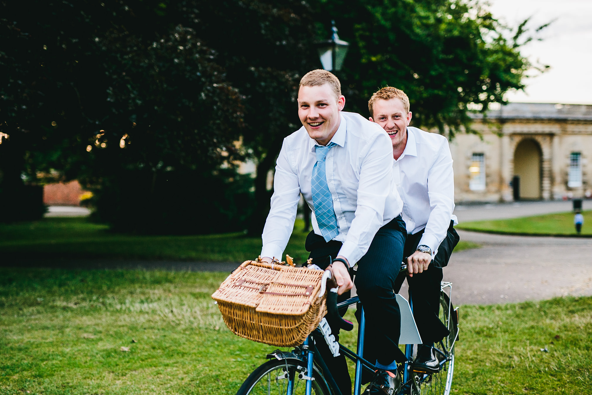 Wedding guests having fun on a tandem bike