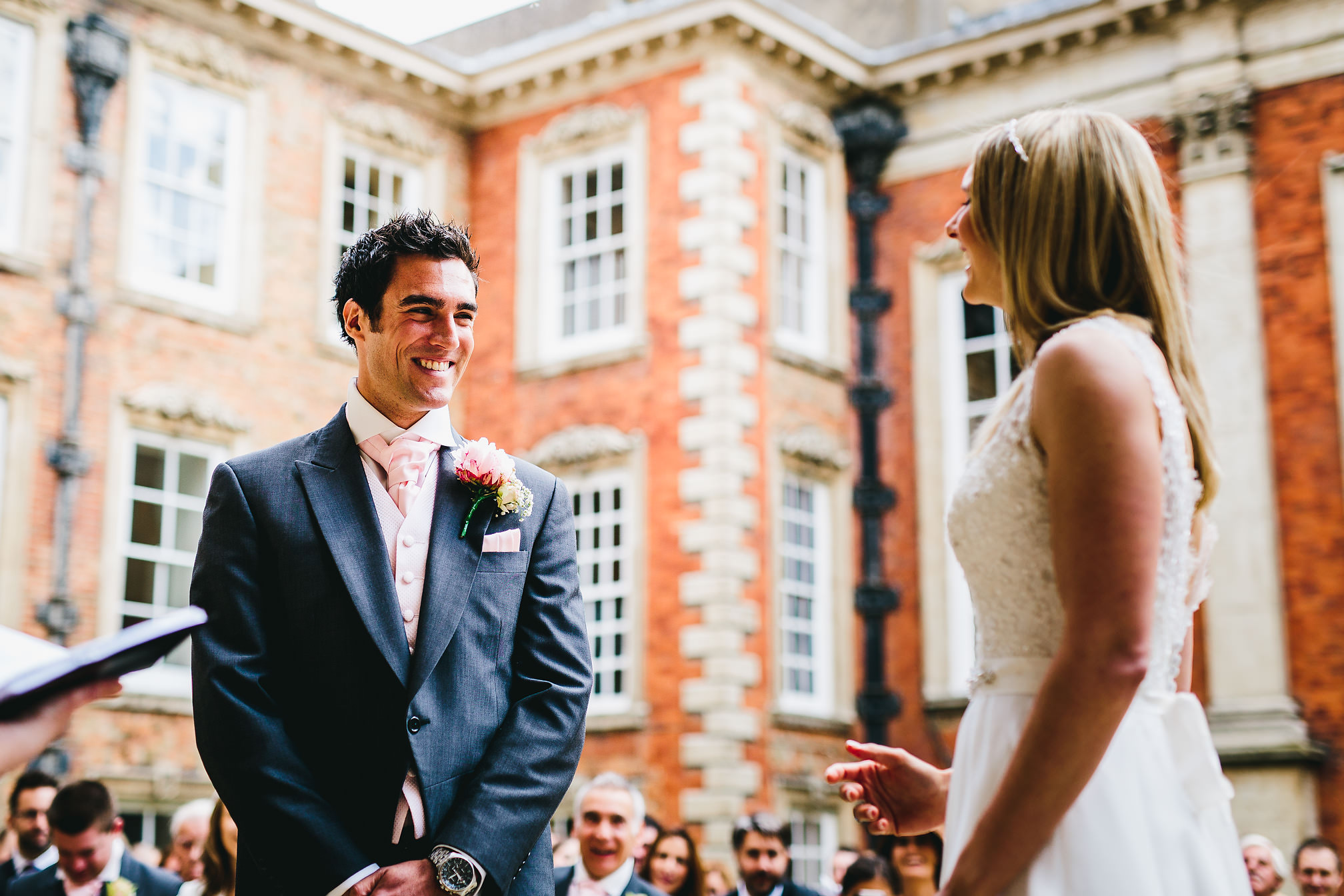 Happy couple getting married - Kimbolton Castle Wedding