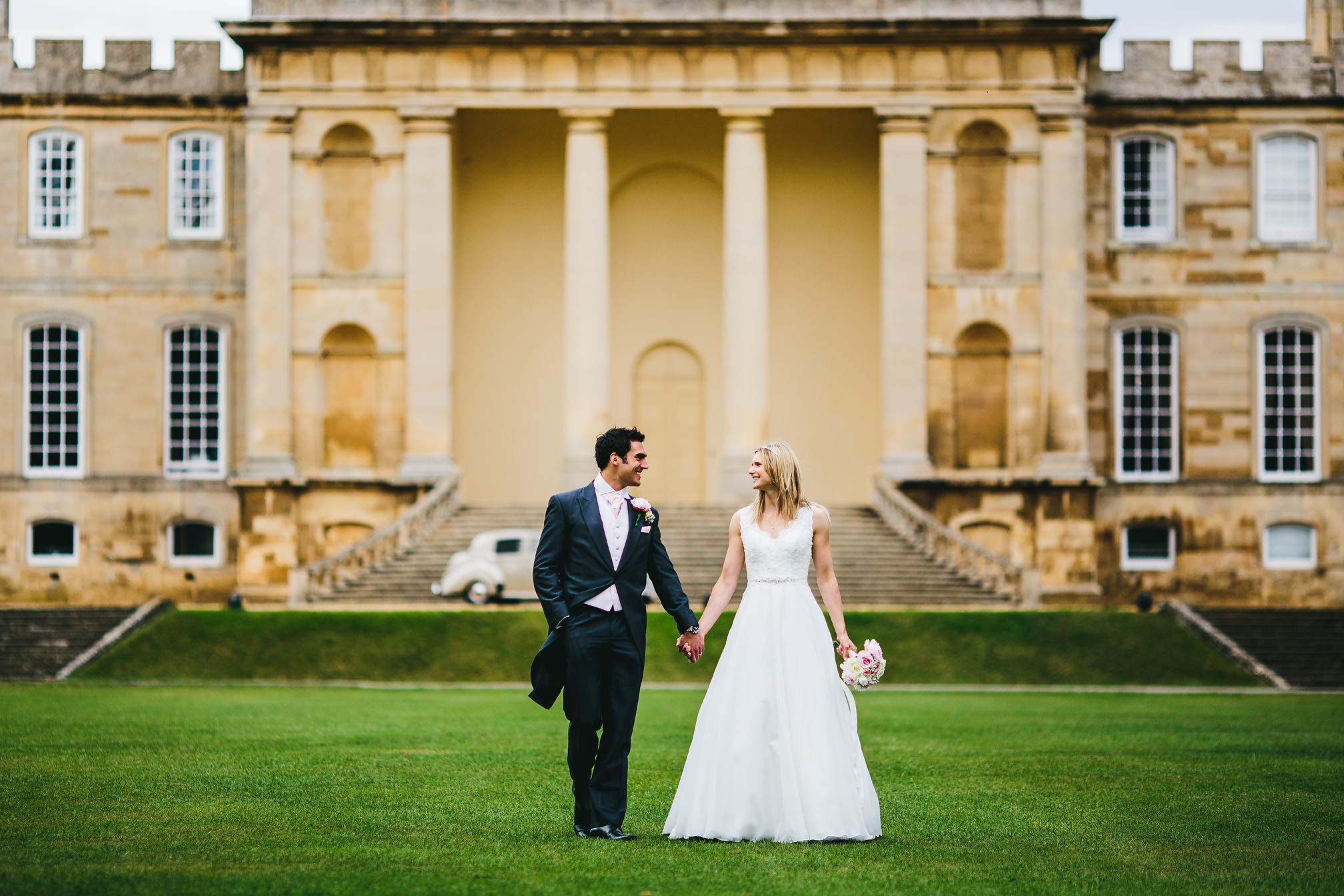 Couple walking away from Kimbolton Castle