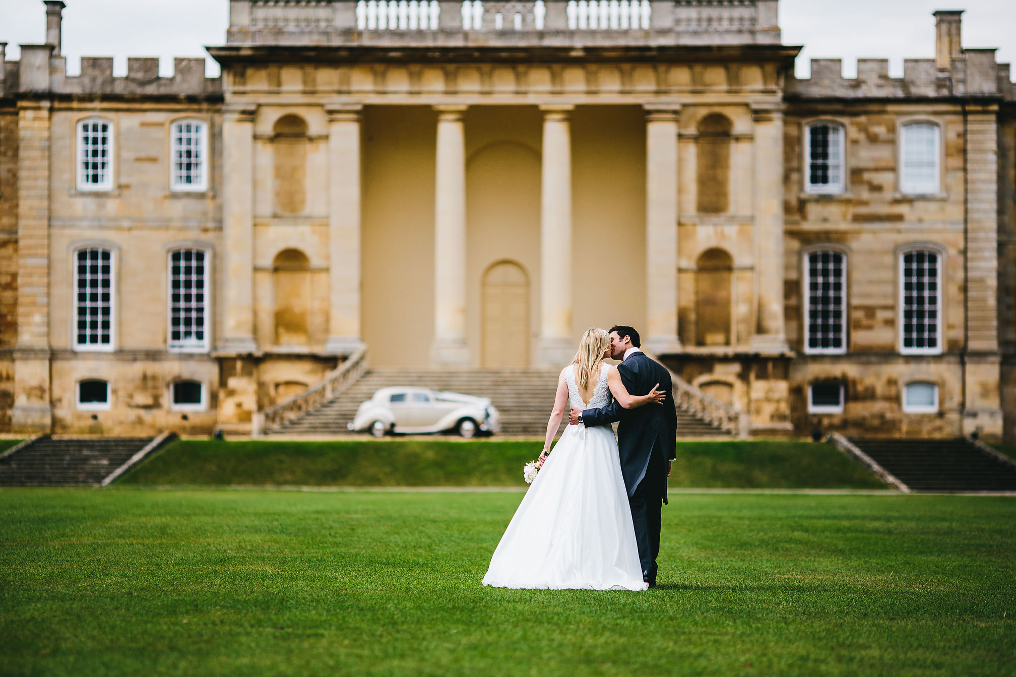 Couple Kissing in front of Kimbolton Castle