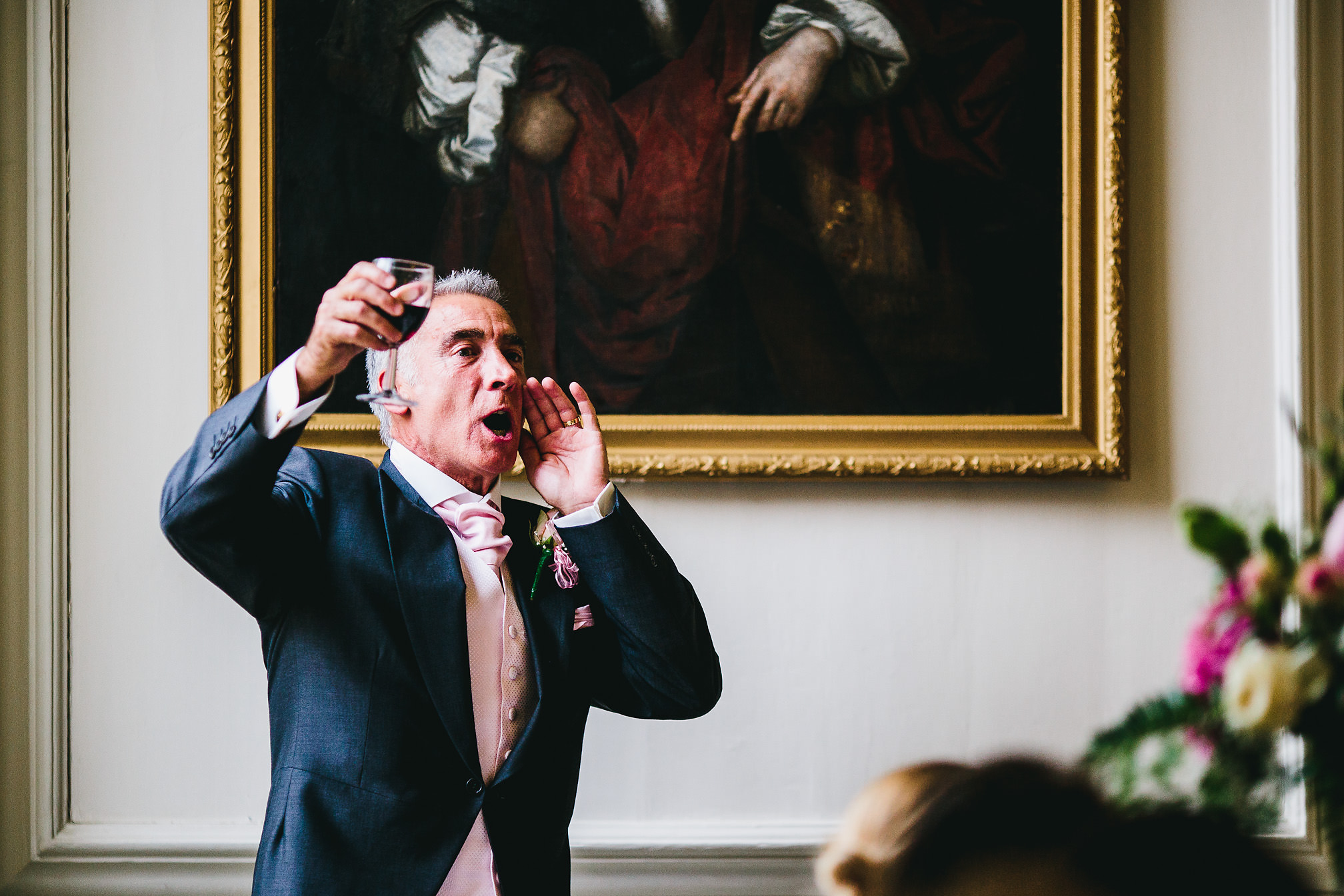 Father of the Groom shouting with a glass of wine