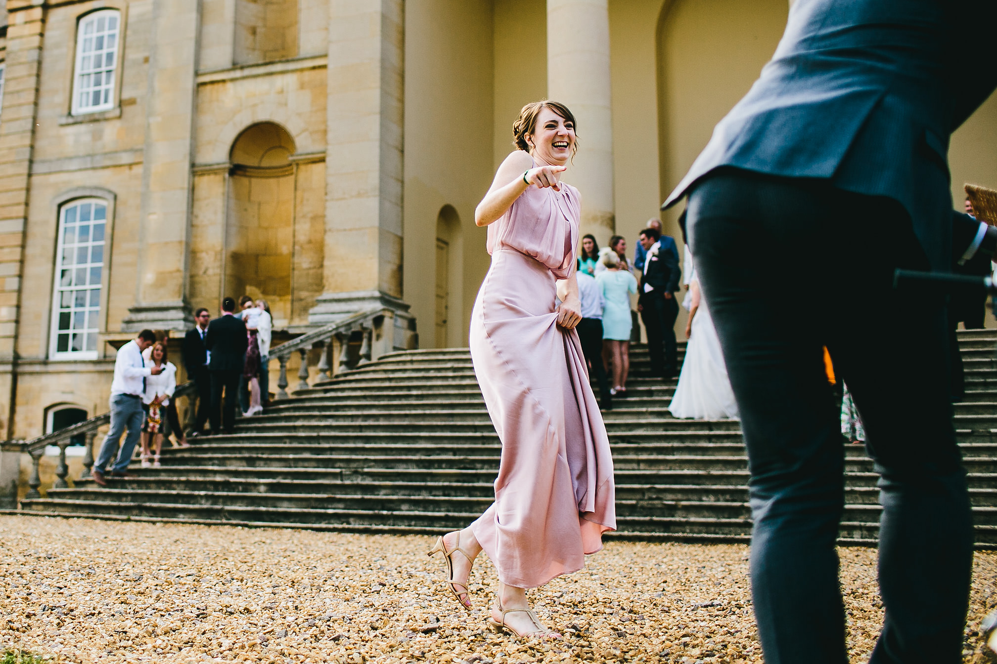 Laughing beautiful bridesmaid
