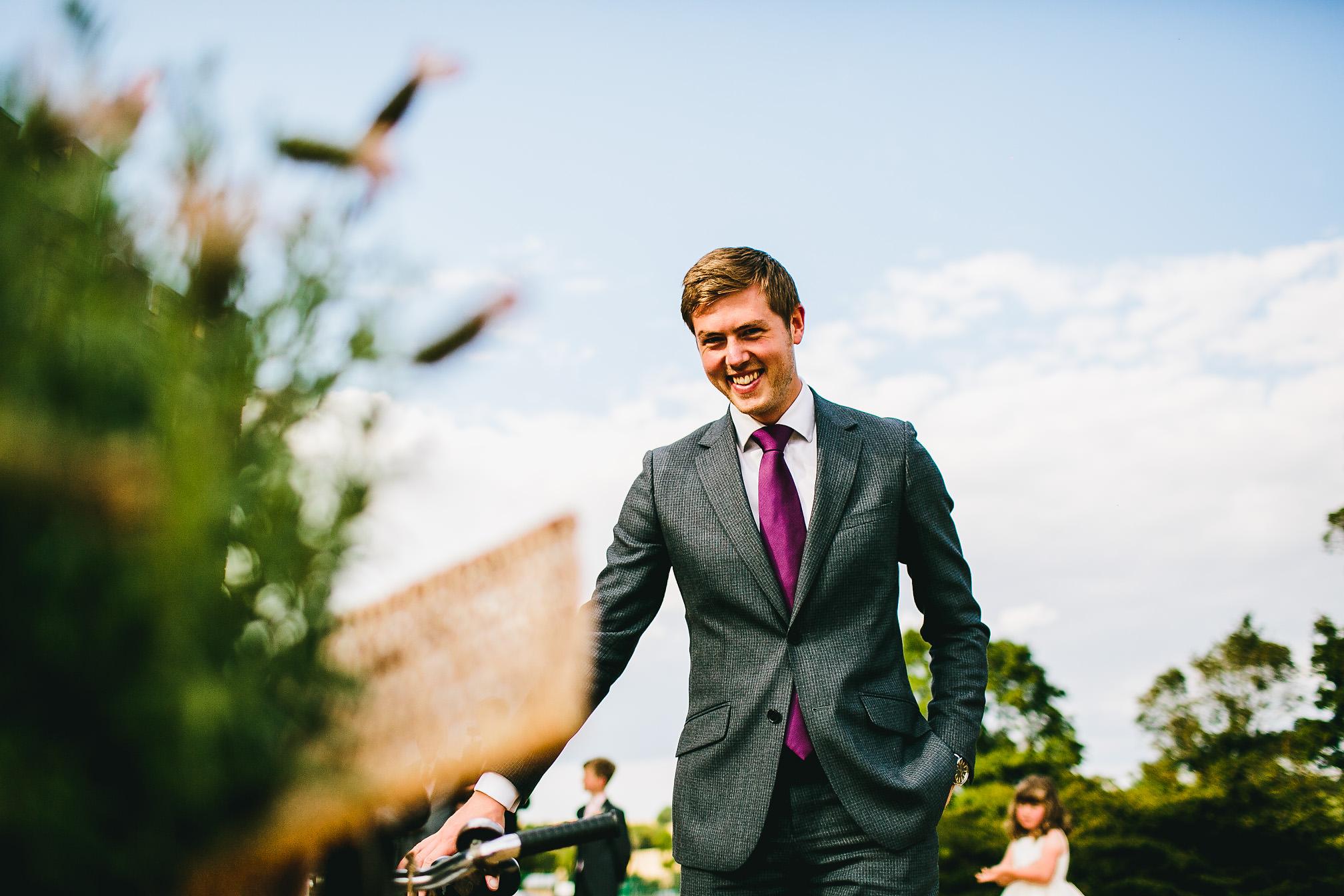 Wedding guest holding tandem biike