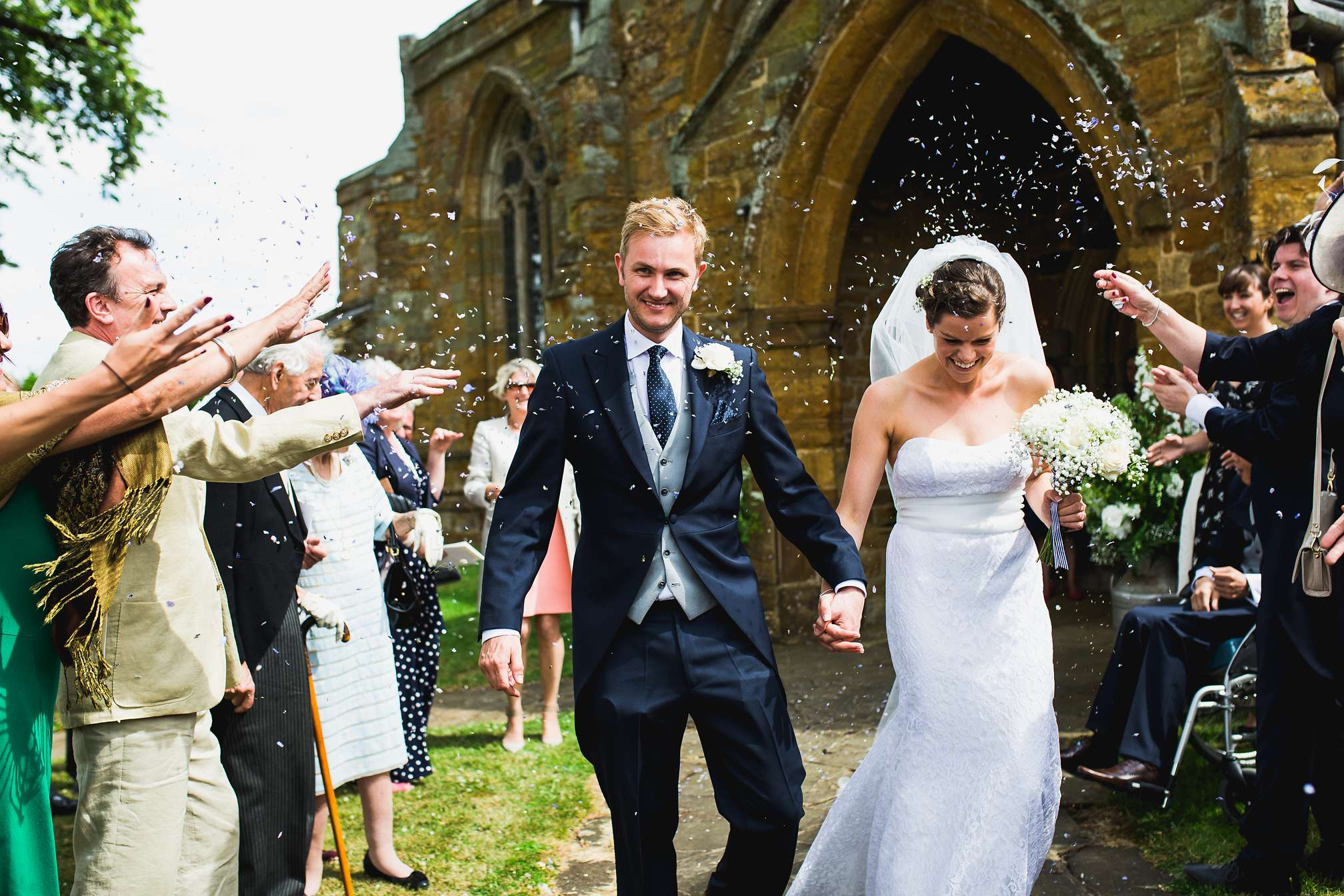 Fun confetti moment, running out of the church