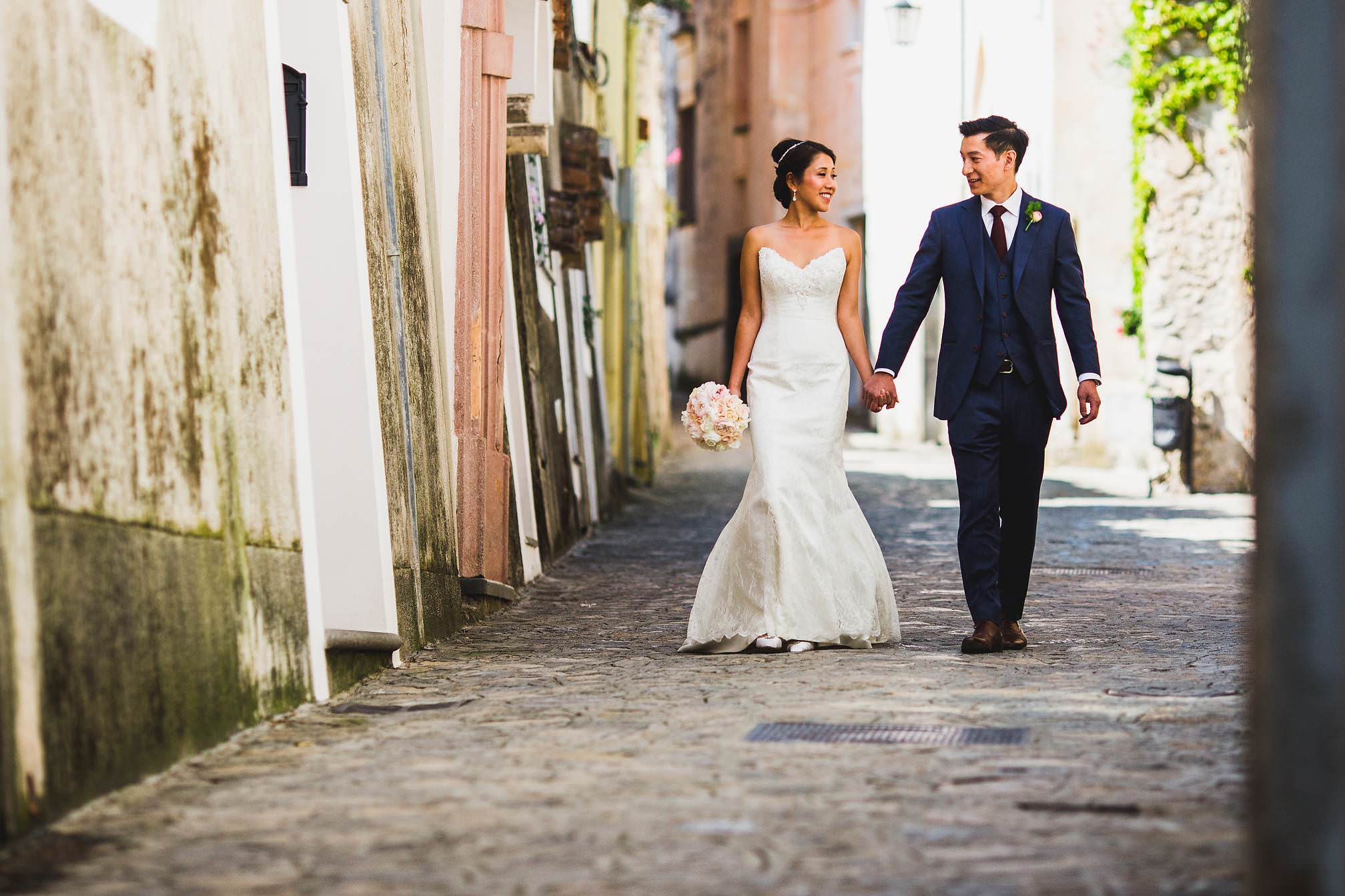 Bride & Groom walking along a Ravello cobbled street