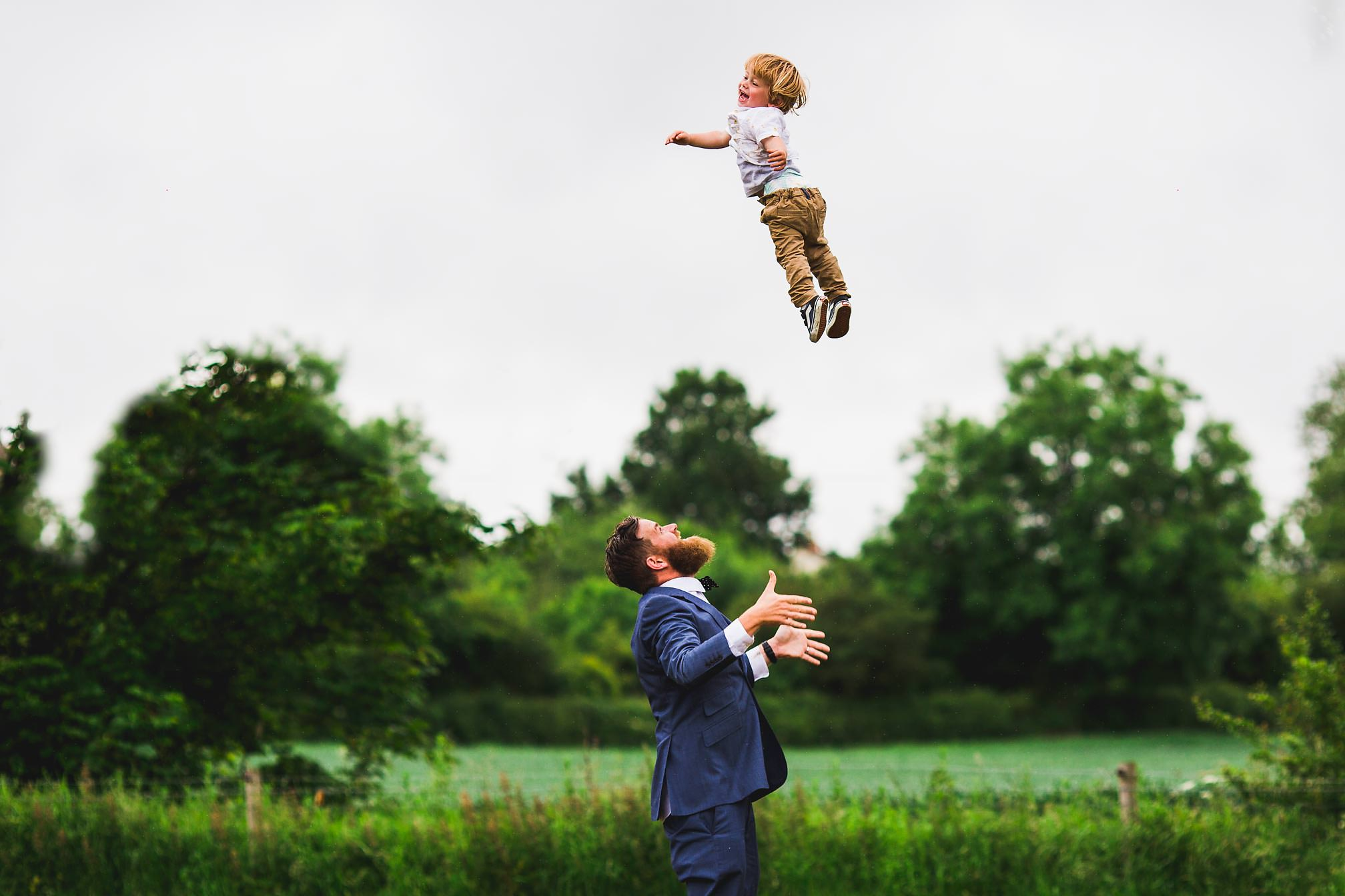 Rangefinder Magazine 30 Rising Stars of Wedding Photography 2017 - Boy being thrown in the air