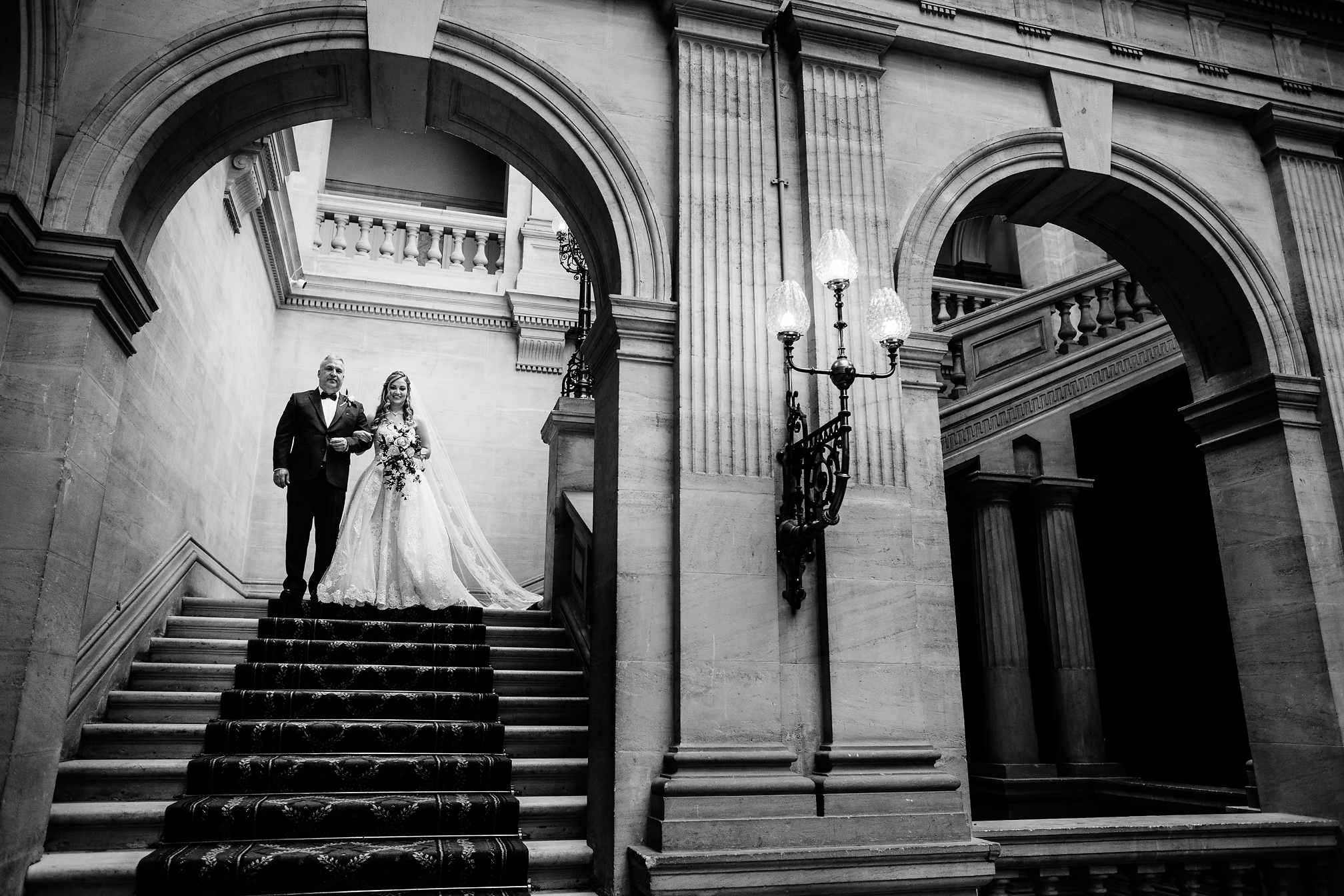 Heythrop Park - Bride walking down the staircase
