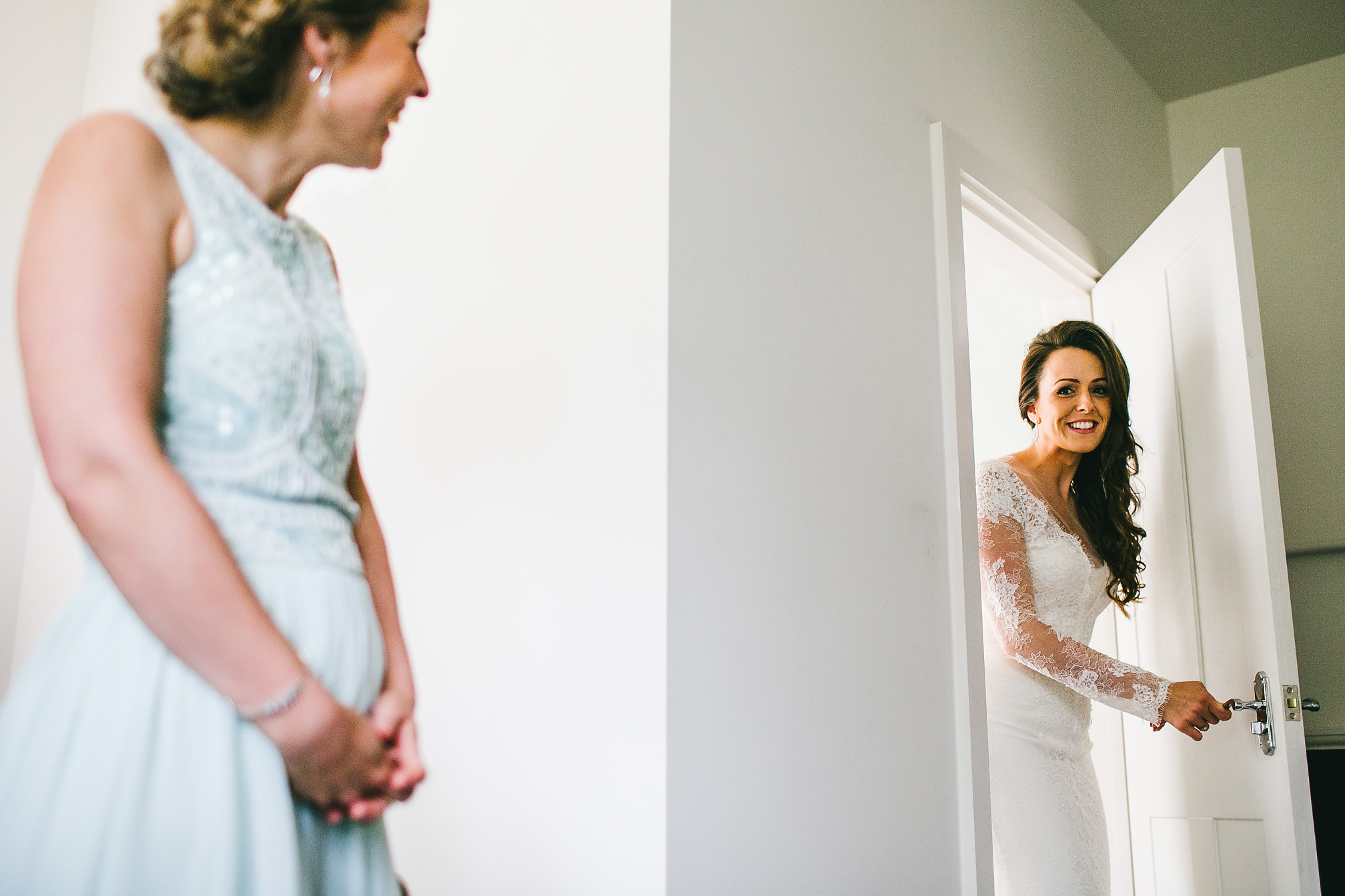 Bride coming out of the bathroom