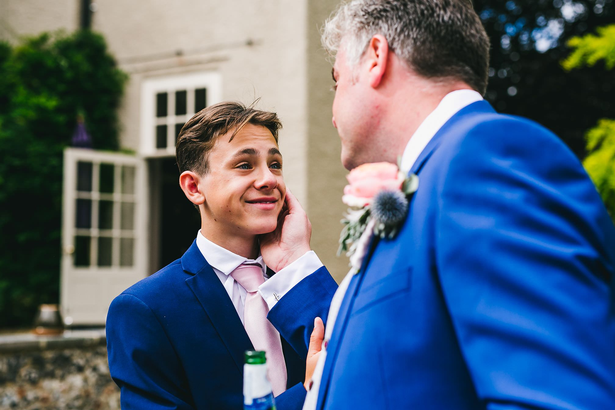 A proud moment between a Groom and his son