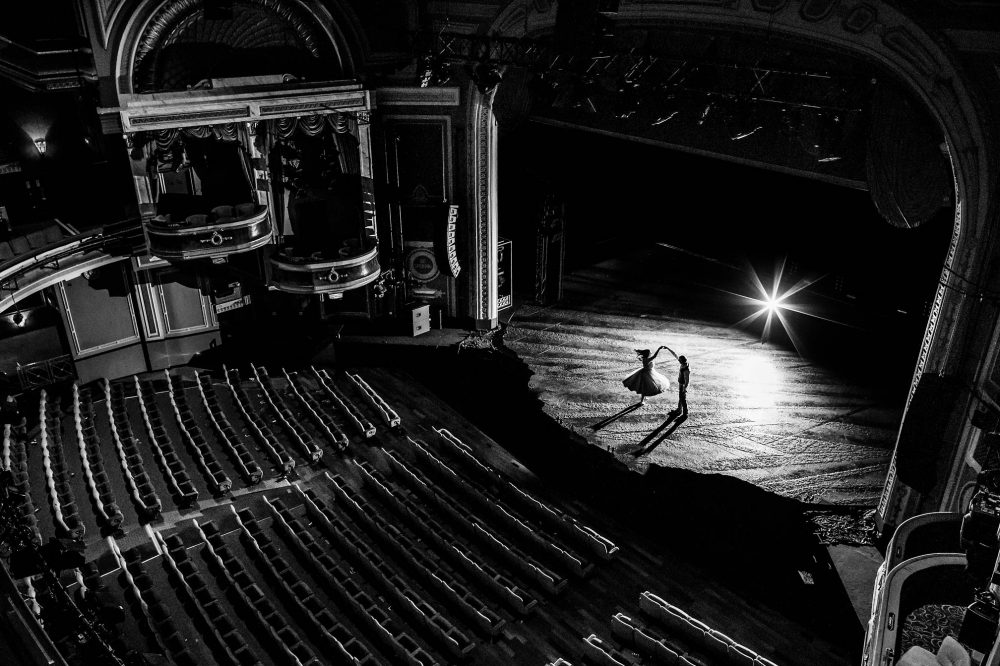 Couple dancing in an empty theatre