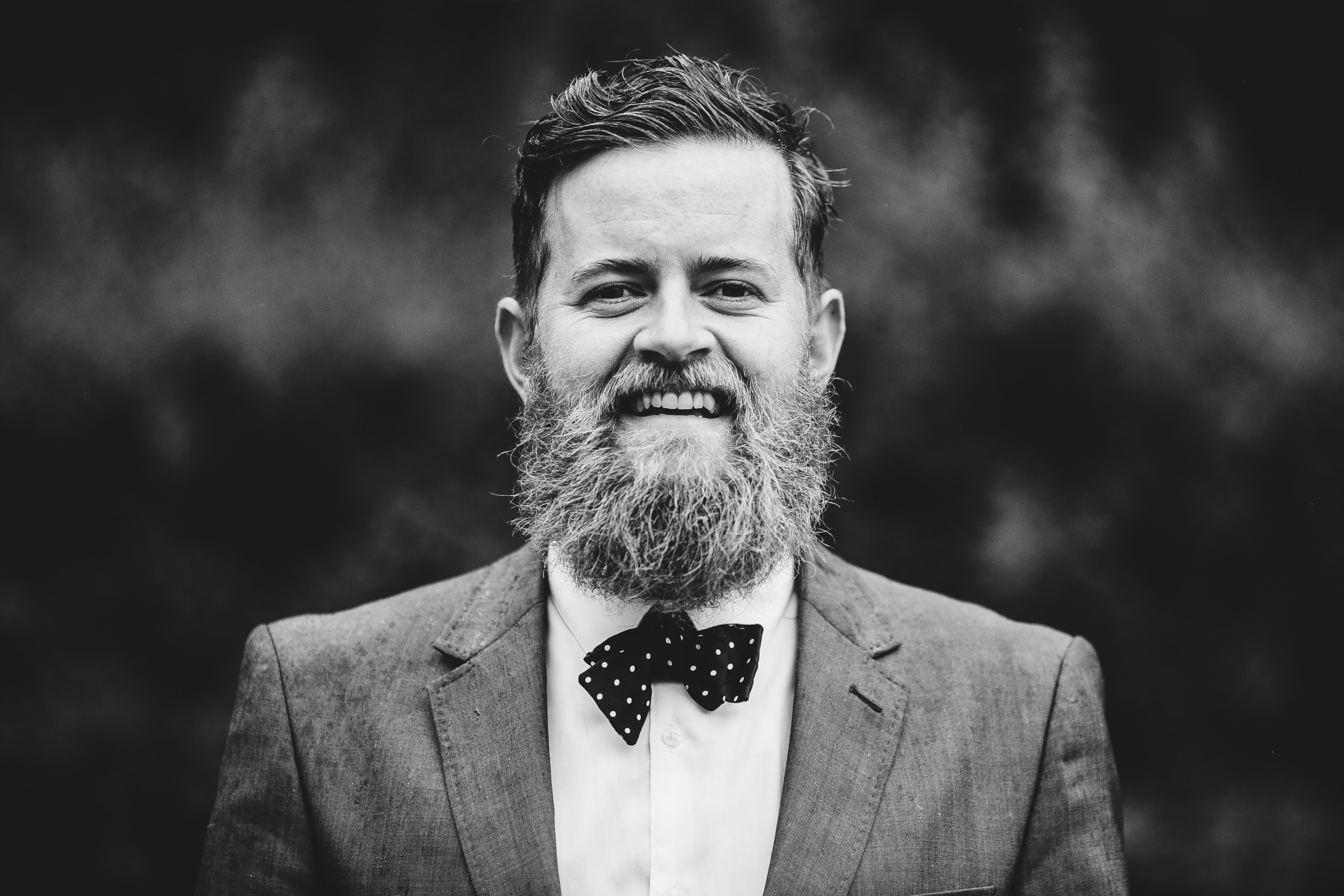 Black and white groomsman portrait