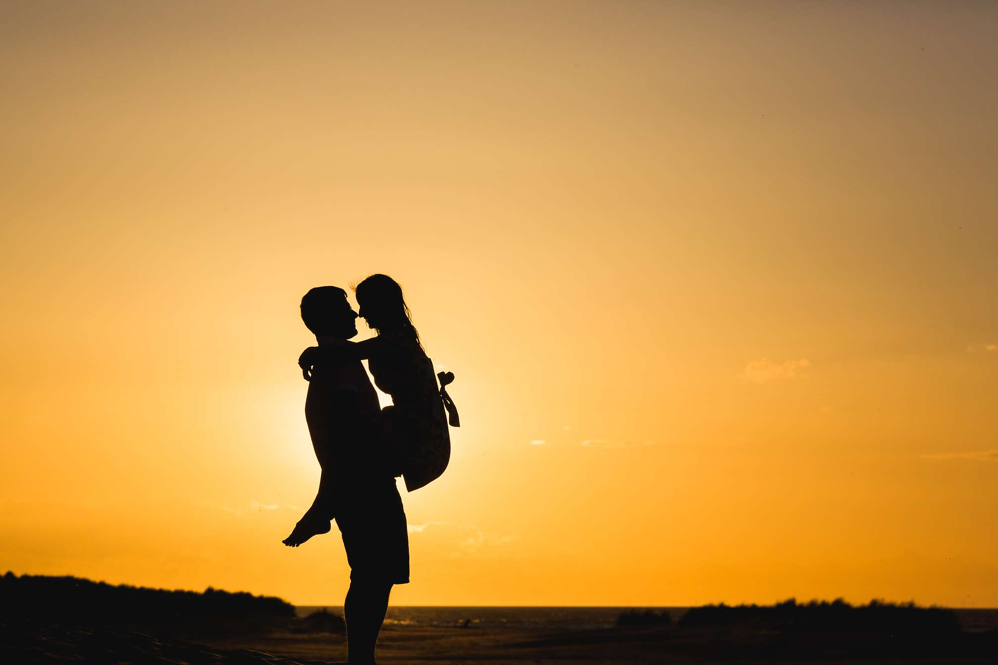 Award winning sunset portrait - Laura and Tim cuddling