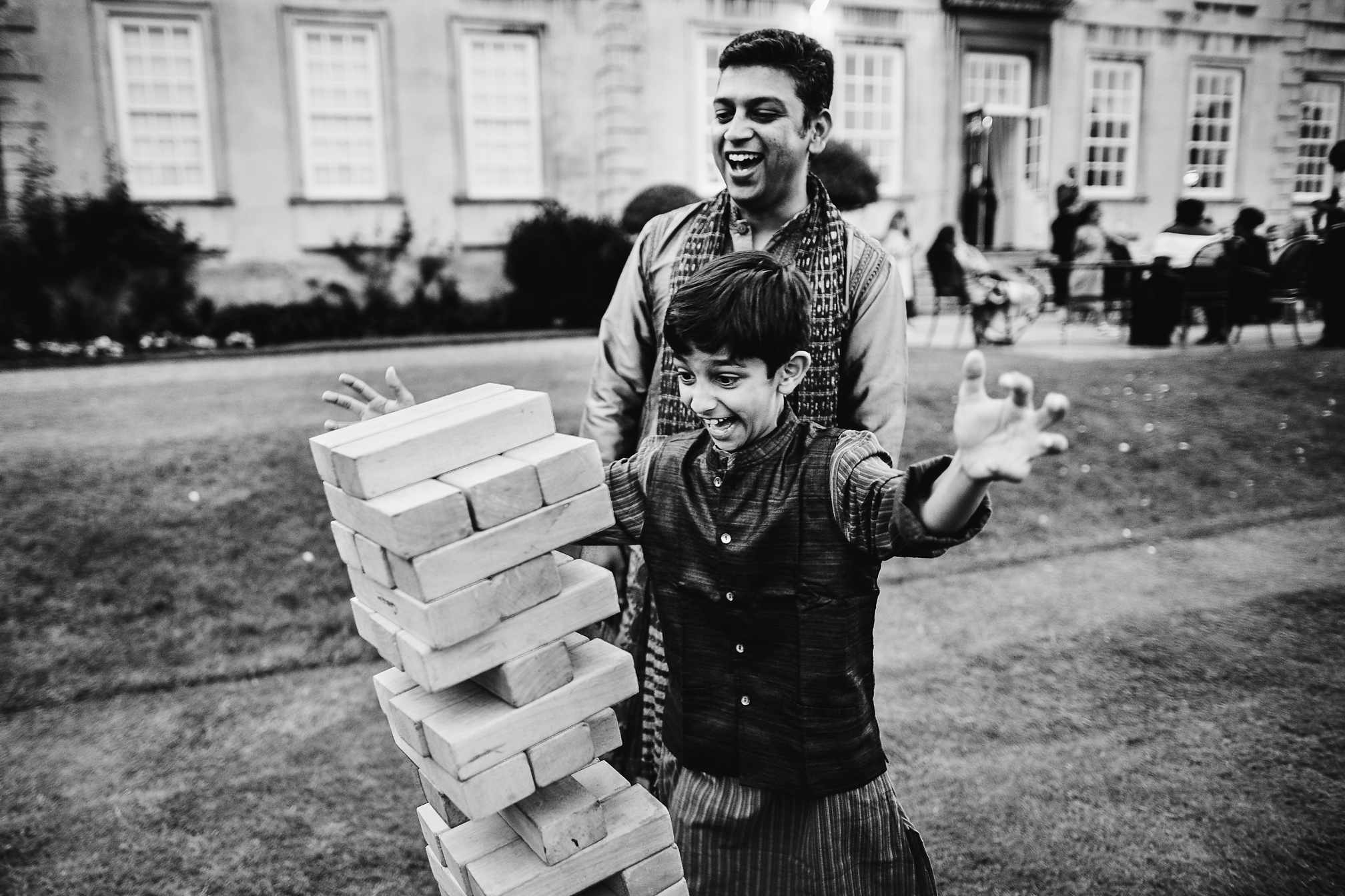 Hilarious young wedding guest playing Jenga